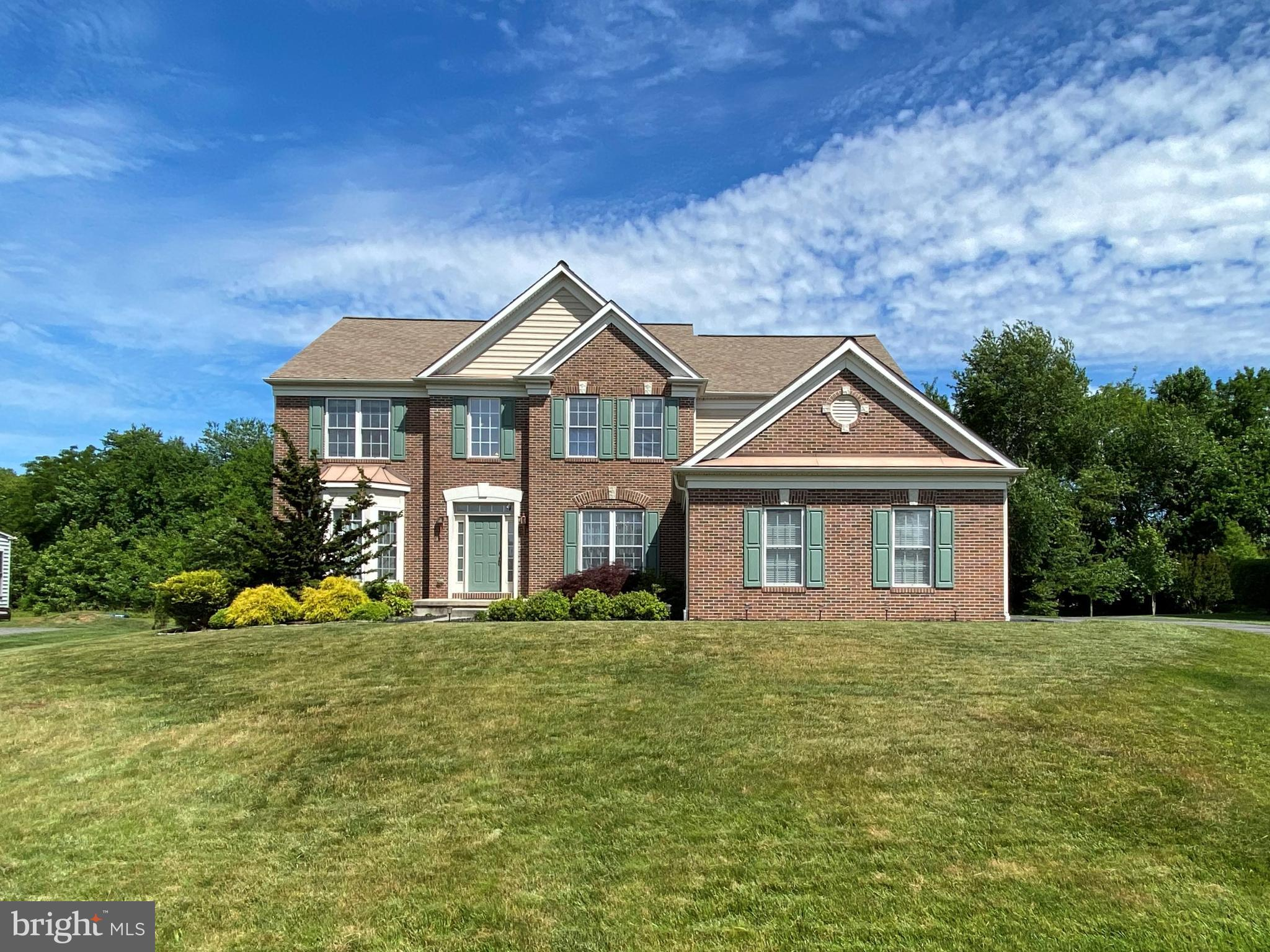 "4BR/2.5BA brick Colonial w/ 3-car garage. 2-story Foyer. Oak hardwoods and 9 ft. ceilings throughout the main level. Upgraded Gourmet Kitchen w/ 42 in. Cherry Cabinets, Corian counter tops, Center Island w/ Gas Cooktop & Breakfast Bar, B/I Microwave, Dual Wall Ovens, Desk, Pantry, and plenty of recessed lights. Sun/Day Room  with stairs to the custom paver stone Patio. Formal Dining Room with decorative crown and wainscot molding and Butler Pantry. Formal Living Room with Bay Window. Expansive 2-story Family Room with wood burning Fireplace complete with marble surround and decorative mantel which is highlighted by raised panel trim all the wall to the ceiling. First Floor Study with French Doors. Main level laundry / Mud Room with utility tub (Washer & Dryer included). Elegant 2-Story Foyer with split staircase with oak treads and carpet runner leads to the ""catwalk"" style upstairs hallway. The Master Bedroom Suite features a tray ceiling with ceiling fan and an extra large Walk-In Closet w/ Laundry Chute.  An upgraded private Master Bath with ceramic tile, double sink vanity, oversized stall shower, and large soaking tub completes the offering.   Bedroom #2 has its own Walk-In Closet and BR#3 has semi-private access to the Hall Bath. Bedroom #4 has a double sized closet. The unfinished basement was intentionally designed with extra high walls, walk-out stairs, and roughed-in plumbing - all desirable upgrades if you finish the space at some point in the future. Dual zone High Efficiency HVAC system. This 0.62 acre lot backs to community open space for added privacy. Northern most community in the highly acclaimed Appoquinimink School District.  This Pulte-built home offers a level of style and finish you don't see in many homes and the stucco-free exterior means low maintenance and no concerns now or in the future. Put it on your list to see today!"