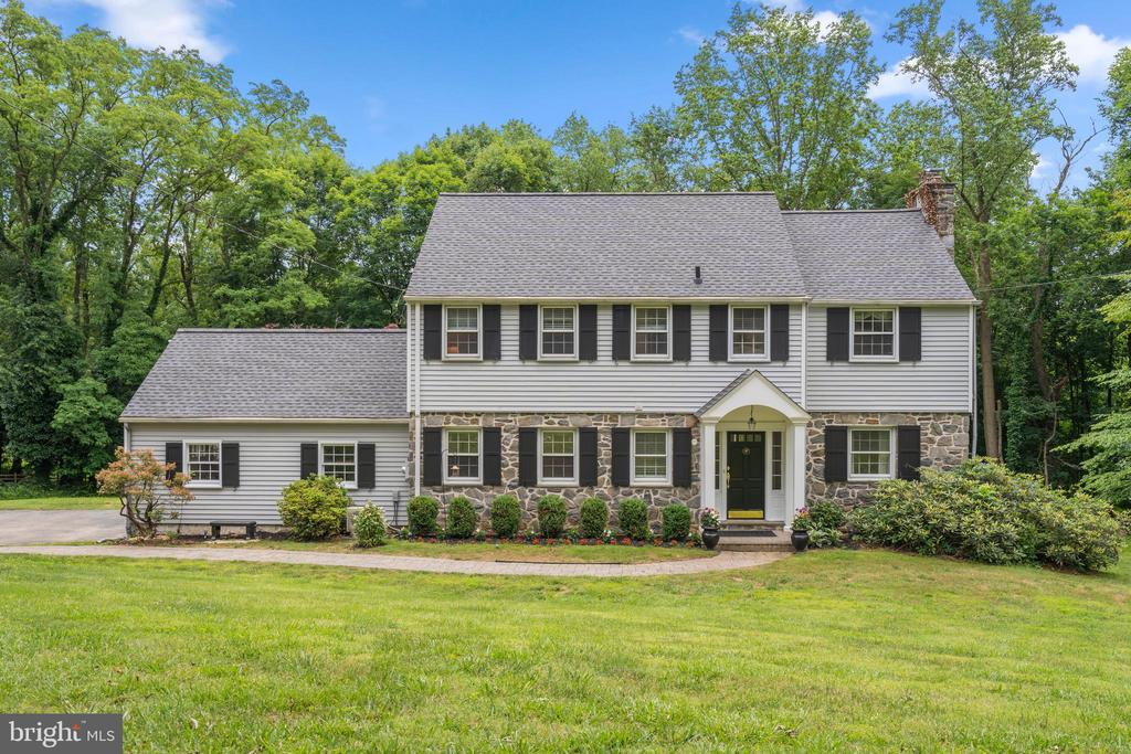 A rare opportunity awaits to live in a beautiful Colonial home on 1.34 acres at the end of a quiet cul-de-sac in the award winning Radnor Township School District.  This charming home offers many amenities, including a fully renovated kitchen, a multifaceted deck and a glamorous master bathroom.  This 3,246 sq. ft. 4 bedroom, 3 ~ bath home is perfect for a family who wants a large yard and privacy. The kitchen and bathrooms  have all been renovated. The kitchen was renovated in 2009 with a more open floor plan, beautiful marble counter tops, stainless steel Jenn Air appliances, and Brazilian Cherry hardwood floors that continue throughout the entire first floor.  French doors in the living room and dining room bring natural light into the rooms and lead out to a deck that spans the length of the house and affords an effortless indoor-outdoor flow.  This impressive 62-foot Trek deck offers privacy and is also great for large gatherings of friends and family. The large living room features a gas fireplace with original hand painted Delft tiles. The second floor comprises the master bedroom, master bathroom, three additional bedrooms and another full bathroom. The master bathroom, a new addition added in 2006, has a vaulted ceiling, his & her custom stone vanities, a large whirlpool soaking tub, shower stall and heated floor. The finished lower level walks out to a stone patio and the large rear yard and includes a spacious family room with a second gas fireplace, a new full bathroom, laundry area and an extra room that can be used as a home office, play room, workout room or 5th bedroom.  This property is convenient to downtown Wayne, King of Prussia shopping, major roadways as well as the Septa/Amtrak rail systems.