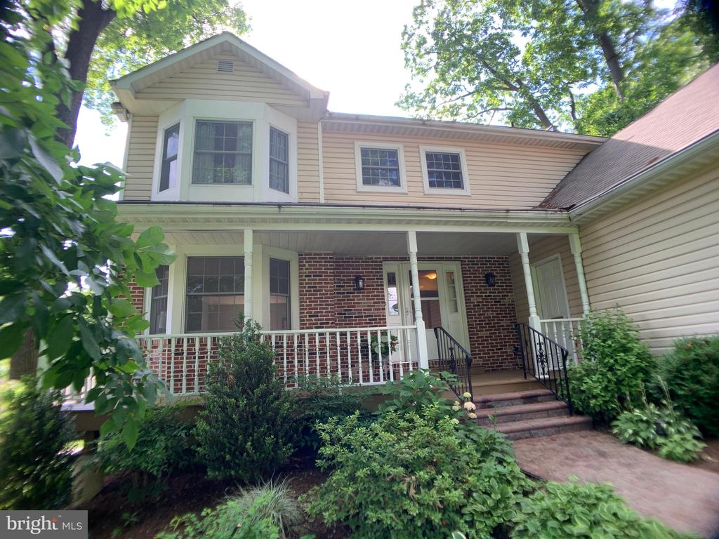 """Welcome to 110 Fennerton Road located in the sought after Valley Hills neighborhood!  Enter this charming home via the inviting covered porch.  A gracious 2 story foyer with a handsome winding staircase sets the stage for this lovely home.  The light-filled Living Room features a large bay window  offering both seating as well as a gracious focal point.  Just beyond and adjoining the kitchen is the spacious dining room -- a perfect place for entertaining groups large or small.  Abundant countertops and cabinets in the kitchen and open flow to the family room are attributes every homeowner will enjoy.  Key features of the family room are its generous size,  handsome brick fireplace and an entire wall of bookshelves and cabinets.  A glass sliding door leads to a beautiful Sun Room with windows on three sides.  Just outside is a deck that is perfect for a quiet moment of R & R.  A Powder Room plus Laundry Room with direct entry to the two car garage complete the first floor.Walk up the winding staircase to a landing area that connects the four bedrooms and two full bathrooms .  All bedrooms have good closet space including one larger closet that offers either additional storage or a hideaway nook.  The 3 bedrooms are bright and generously proportioned with easy access to a full bathroom.  The large master bedroom offers privacy and windows on two walls, including a bay window.  The recently renovated en-suite bathroom features high ceilings with skylights, two sinks, dressing table and walk-in glass shower. The location of this lovely house on a quiet street in a """"walk to train"""" neighborhood in the award winning Tredyffrin Easttown School District make 110 Fennerton Road a must see property!"""