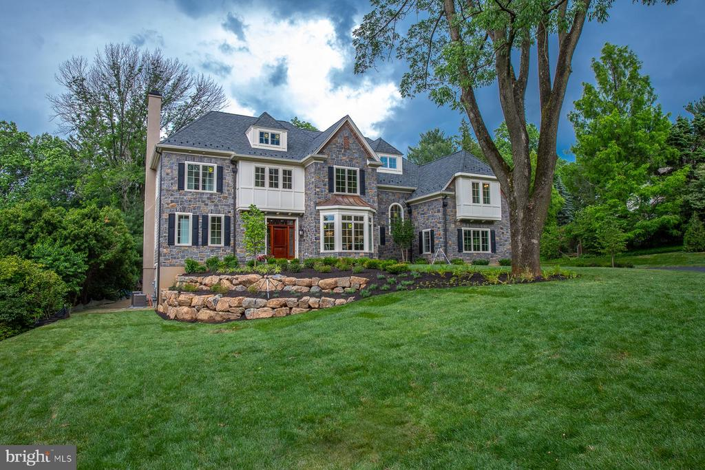 Another masterpiece by Award Winning Builder, William G. Smith, Jr., finished and ready for immediate occupancy.  It is located in prestigious Gladwyne, PA.  This home is a combination of Contemporary and Traditional Main Line Philadelphia Design.  Built to the highest standards of quality with 5 Bedrooms, 6 full Baths, and 2 Powder Rooms. The home is elegant, and at the same time offers a casual life style.   It is very spacious for any type of occasion, and lends itself to entertaining both indoors and outdoors.  Enter through a Custom Mahogany front door with side light windows into a beautiful Center Hall with a Grand Staircase that has a Magnificent Balustrade system. To the left of the Center Hall there is a Guest Powder Room Generous Coat closet and open Staircase to the walk-out lower level.  The Formal Dining Room is located to the right of the Center Hall, as you come in, and features a  Bay Window, that is full of light, 12 inch Crown Moldings, Chair Rail with  Wainscoting below and a Crystal Chandelier. Straight ahead of the Center Hall you will discover the Fabulous Great Room with Coffered Ceilings, and a Dramatic floor to ceiling Porcelain Fireplace that is both wood burning or gas.  Directly to the left of the Great Room, the Living Room/Study is located  with another Dramatic Porcelain Fireplace and featuring pocket doors for complete privacy.   Beyond the Great Room you will find a ~State of the Art~ gourmet Kitchen with Custom Cabinetry, White Quartz Counter tops, 4 Ft. Sub-Zero Refrigerator/Freezer, 4 Ft. 8 Burner duel fuel Wolf Range, commercial strength Range Hood with a split exhaust motor that is located in the attic  leaving  the kitchen completely silent,  Miele Dishwasher, Sharp Microwave.  Deep White Porcelain Farm Sink with Rohl upscale faucets, 10 Ft. Island with White Quartz Countertops and Vegetable Sink, Pendant Lights and seating for 4.  This Kitchen area is a Chef's Dream and includes a Generous Breakfast Area for informal meals  a