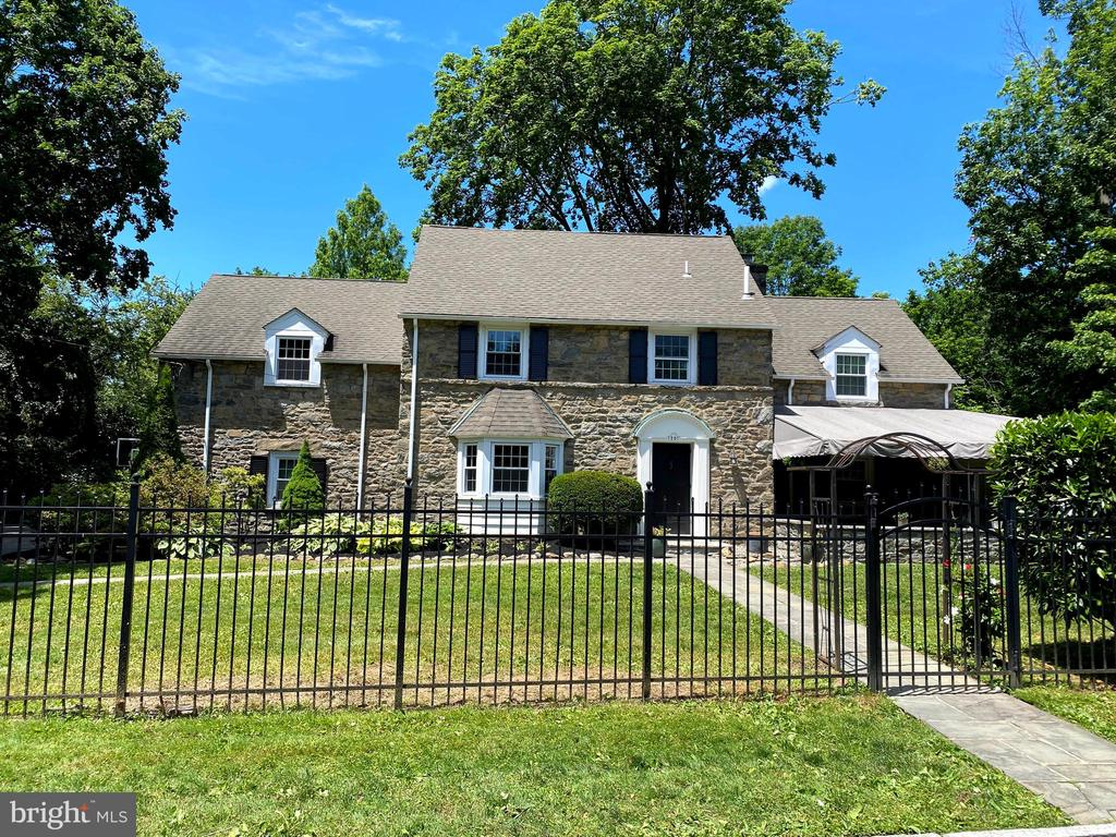 *Price adjustment to reflect correction of inaccurate SF from public records*Location is everything! Welcome to this 1930's stone colonial, offering 5 bedrooms, 3.5 baths and 2 car attached garage. This home is sitting on a flat fenced corner lot in the desirable Wynnewood Estates neighborhood and coveted Lower Merion School District.  Walking distance to Wynnewood train station, South Ardmore Park, the many restaurants, shops, and minutes to Center City. The newer front flagstone patio with three sided sitting wall and seasonal canopy is perfect for entertaining. The rear patio boast sitting areas, snack bar seating for six, wooden arbors and a stone fire place. First floor has entry foyer with coat closet and adjoining  half bath, to the left is a dining room and open kitchen with a full compliment of stainless appliances, granite counters  and breakfast bar seating for five. To the right is a spacious living room with wood burning fire place and french doors that lead to the year round sun room, with access to both patios. Second floor has a large Master bedroom with master bath. Three additional spacious bedrooms are joined by a long hall and full bath to complete this floor. Third floor en suite is ideal for visiting family, Au Pair or private office. The partially finished dry basement makes for a great family room/play room with additional  built in desk and bookshelf units. There is an adjoining laundry room and ample storage in the unfinished area. Improvements include new windows,kitchen, bathrooms, roof, and central air conditioning. This invitingly warm family home won't last long, make your appointment today.