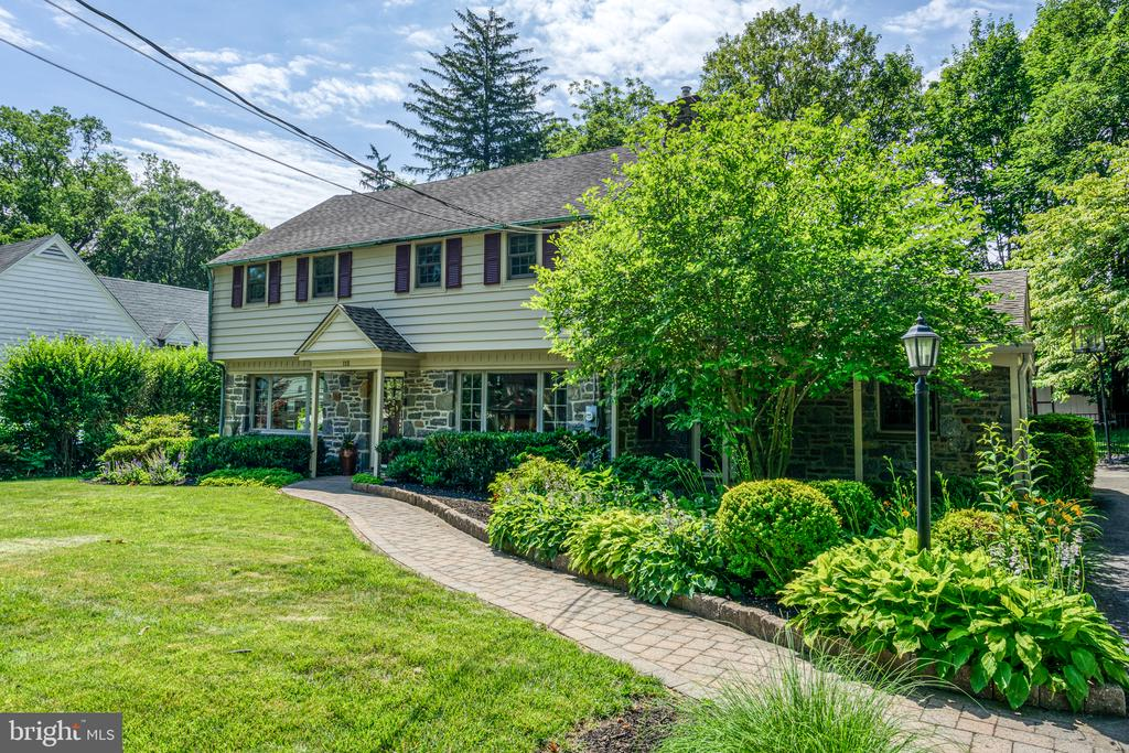 Meticulously renovated & updated  stone colonial with a covered front porch situated on a quiet tree lined street. Offers great walkability to Ardmore, Wynnewood and Suburban Square. This home has been thoughtfully designed inside and out over the years. This beautifully landscaped home has a hardscape walkway, large fenced level backyard including a separate fenced gated dog run area plus a shed. Large eat-in chef's kitchen complete with custom stained cabinetry, stainless steel appliances, gas 5 burner cooktop, double ovens with convection, microwave, french door refrigerator, granite countertops, pantry closet, desk area, breakfast bar plus a large dining area. The kitchen has Pella sliders leading to the patio and backyard perfect for outdoor entertaining. There is a mudroom with a large closet that opens to the driveway. The formal living room has a gas fireplace with limestone surround, large bay window, custom cabinetry with a polished limestone countertop & upholstered window seat and recessed lighting. The spacious family room has a vaulted ceiling with natural wood beams, custom built-in cabinetry, exposed stone accent wall plus 2 outside entrances. The gracious dining room has a bay window and crown molding. A powder room completes this level. The master bedroom has an updated stone bathroom with a walk-in shower and luxurious finishes and customized closets. The are 3 additional large bedrooms all outfitted with California Closets.The hall bath has a tiled tub/shower. There is a 2nd floor deck offering great expansion opportunities. The partially finished basement has a playroom, laundry room plus great storage space. This home has great natural light, neutral hardwood floors throughout, recessed lighting, security/fire alarm system, external motion sensor lights, architectural roof, replacement windows, attic fan and much more. Close to both the Ardmore and Wynnewood train stations. Blocks to South Ardmore and Linwood parks. Choice area for High School. Close to Lower Merion High School. This home will not disappoint. A gem to show!!!