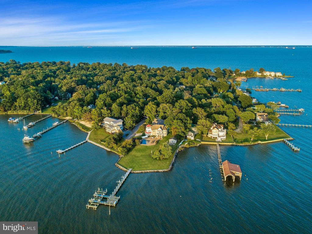 Welcome to 1291 Hollywood Avenue, a stunning waterfront retreat on the Annapolis Neck. Situated right on Fishing Creek, this point lot has both space and expansive views that take your breath away. In addition to the house, the 1.03 acre parcel has roughly 310 feet of shoreline, a serene waterside pool, ample yard space, a crab shack, and a deepwater pier with 5 slips and 8 feet MLW - all with southern exposure. This spacious custom build boasts over 7,200 square feet with five bedrooms, several living areas and entertaining spaces, a massive open concept waterside kitchen and dining area. The whole property has tastefully updated features that include custom closets throughout, a beautiful wine cellar, a separate mudroom, several reading nooks, play spaces for the littles, and modifications done to accent the view from your kitchen and master bedroom. Everything has been thought of. Located just 5 miles from downtown Annapolis, with easy access to Route 50 and I-97.