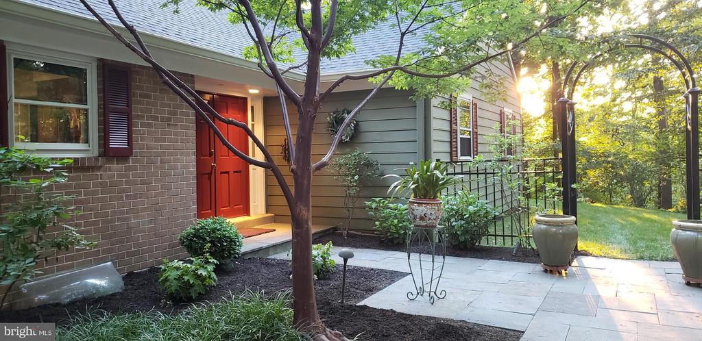 Tranquility abounds in this charming Ranch in  Paoli nestled adjacent to Airdrie Forest Preserve.  This woodland retreat has been beautifully updated and is in walking distance to the Paoli Septa Train Station.  The spacious hardwood foyer with two double closets welcomes you to the heart of the home:  the updated kitchen with granite counters, and entertainment bar, ceramic tile floor, double pantry and peninsula.  The sunny breakfast room also has a desk computer station.  Convenient mud room/laundry with ceramic tile floors, charming  bead board powder room, and walk-in utility closet leads to the large two car garage with new doors.  Right off the kitchen is the spacious family room with raised hearth brick fireplace, with wood storage compartment, built-in bookcases and cabinetry and custom sliding door to spectacular rear yard.  It's a mini Longwood Gardens!  The dining room with custom sliding door also leads to the patio for perfect entertainment possibilities.  The adjacent living room with crown molding and brick fireplace is a peaceful retreat.  The master suite had a large double closet and an updated master bath with large ceramic tile clear glass shower, new counters, faucets, cabinets and lighting.  Three other spacious bedrooms, all with double closets also have hardwood floors.  The hall bath boasts a new double vanity with tub and shower.  The basement  had been finished with carpeting, built-in cabinetry and closets plus a workshop area and new electric baseboard heaters.  This home has constantly been updated with new roof and gutter guards (2020),  Fresh paint thru out, refinished hardwood floors (2020), newer HVAC with whole house humidifier and dehumidifier, ultraviolet filtration,  80 gal hot water heater, and custom Anderson sliders (2014) .  Protecting this private backyard oasis is an estate fence with deer proof addition and arbor gates.  An electric dog fence for pets as well.  All this in walking distance to shopping and restaurants in 