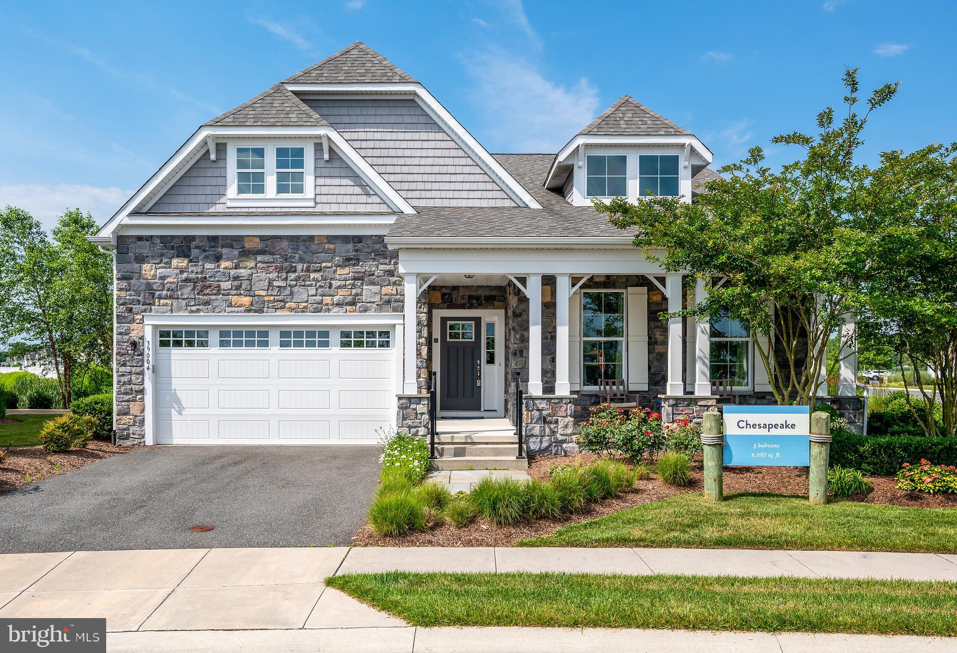 """Move in Ready! The impressive Chesapeake Model is finally available to purchase in Millville by the Sea.  As you enter through the stunning foyer into the main living area, the home opens up to a beautiful kitchen with an oversized granite island,  overlooking the sunroom and vaulted ceiling great room. Upgrades in this beautiful model home include a wine bar and large office/library/4th bedroom with french doors and numerous windows, providing natural light throughout. A spacious master bedroom comes with dual walk-in closets and a beautifully appointed master bath.  The oversized guest bedroom with shiplap walls has an ensuite bathroom that can also be accessed from the hallway by other guests.   All of this plus multiple closets and a separate powder room complete the spacious 1st Floor.  On the 2nd floor you will find a loft with private guest quarters and full bathroom adding a separate living space for family or guests.   Enjoy outdoor living space with the roomy screened porch, leading out to a gorgeous paver patio, with built in fire pit and grill. A 2 car attached garage also has additional storage space above.  You can't beat this location, as the end house on a quiet street of just 4 homes, right across from all of the amazing amenities Millville by the Sea has to offer! This home is being sold """"As Shown"""", completely move in ready  with all of the gorgeous designer furnishings and touches included.  Just bring your beach bag and enjoy the rest of the summer... Call today for your appointment!"""