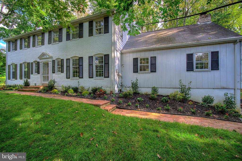 This elegantly renovated 1961 colonial is nestled in a quiet neighborhood in Gladwyne. Welcome to this 5 Bedroom, 3.5 Bath home with 2 fireplaces and beautiful brand new hardwood floors. This freshly painted home makes a great first impression as you walk into the large foyer.  The heart of the home is found in its brand new gourmet kitchen with an open space concept. The kitchen has quartz counters with all new, highly efficient LG appliances and a convenient center island ~ everyones favorite gathering spot. This opens to the sunny dining room with a french door overlooking a brick patio and views of the backyard. The kitchen is adjacent to a large family room with a large brick fireplace.  Entertain in style in the gracious airy, light filled, living room with additional fireplace. Snuggle up with a good book in the cozy library with rich wood paneling. Upstairs, the large master bedroom with large walk in closet has a spacious, completely renovated en-suite master bath with a large tile glass shower and a copper soaking tub.  Also on the second floor are four nicely proportioned bedrooms and two renovated baths. The unfinished basement with freshly painted floor and walls is conveniently attached to a two car garage and great for storage. Mechanical and electrical systems have been upgraded throughout the house for energy savings and efficiency. Located in Lower Merion Township with award winning schools. The Gladwyne Library, shopping, walking trails & train are minutes away. Convenient to major highways, Amtrak and airport.