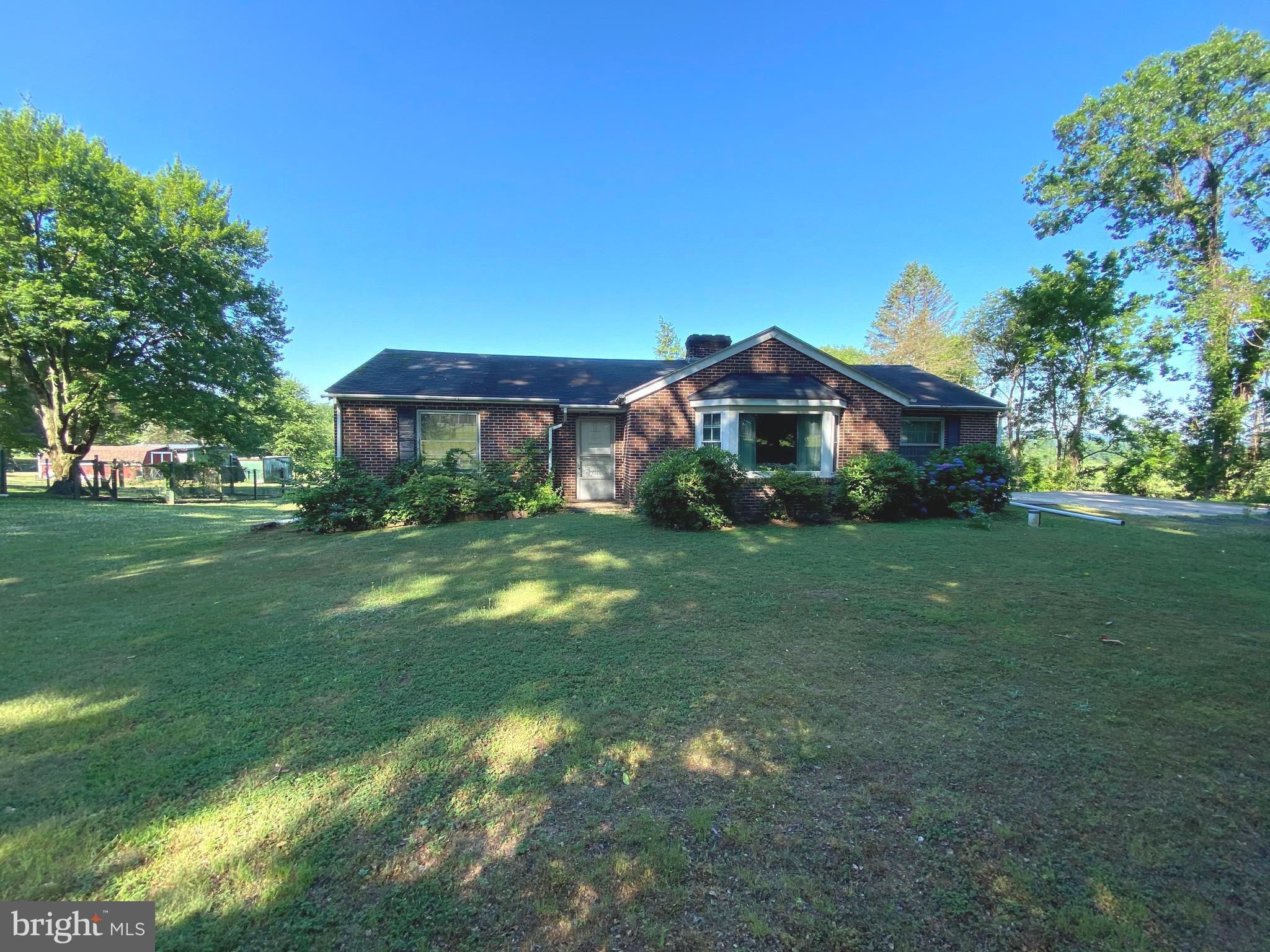 This home provided a lifetime of happiness for the previous owner, and it's time for the next generation to bring it back to life! Have you been shopping for the perfect opportunity to build sweat equity while making a home your own? Look no further! This beautiful brick ranch is situated on a perfect acre with an inground pool and plenty of usable land. A solid wood front door leads to an entryway with hall closet and hardwood floors that flow throughout the living room, dining room, and two of the bedrooms.  The large kitchen could be polished up for a cool vintage look or could be redesigned to fit the needs of the modern buyer. A possible third bedroom, closets galore, and one and a half baths finish off the layout. The basement needs some loving attention, but has the potential for approximately 1000 sq ft of additional living space. The pool needs work, but in its heyday it was the perfect way to take in the open yard and incredible views! There are some newer windows and a 7 year young oil burner. This home has so much to offer the right buyer. Don't miss this fantastic opportunity, and schedule your appointment today!