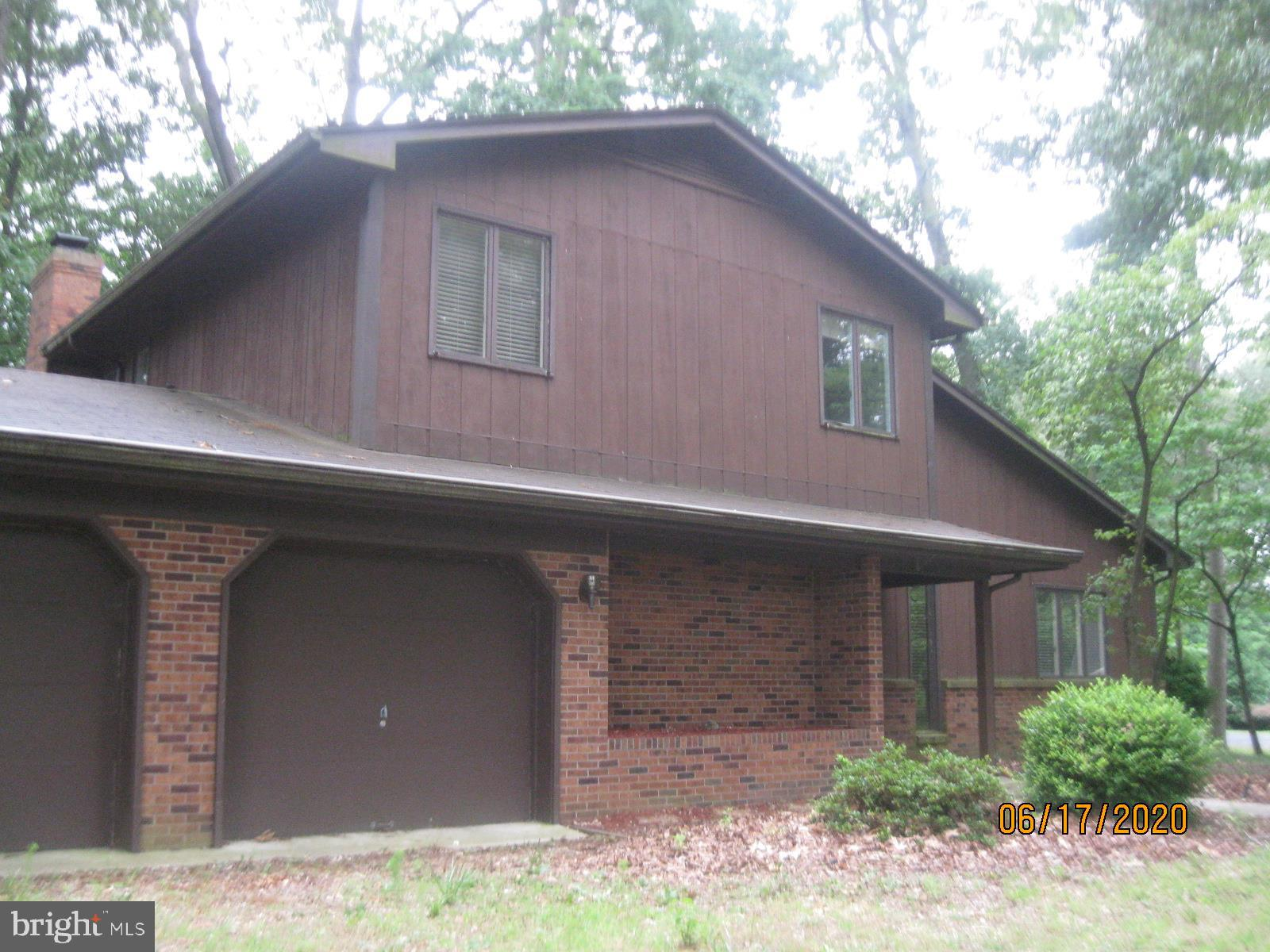 Four bedroom 2.5 bath with attached 2 car garage.  Corner wooded lot and some pond view.  Has formal living , dining and family room. Lot of house here, needs some cosmetic updates.