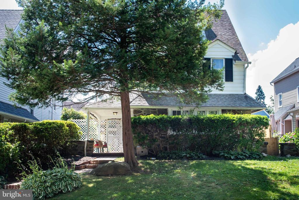 Located on a quiet street in Penn Wynne, this lovely home is awaiting your finishing touches to make it your own. Enter from a covered porch into a large living room boasting a working wood-burning fireplace and the original parquet floors. The parquet floors are carried into the brightly lit formal dining room. The kitchen includes a breakfast area overlooking a greenhouse window. The washer and dryer are also located in the kitchen for your convenience. The second floor includes three bedrooms and the main bathroom.  The bathroom retains the charm and beauty of the original marble walls and floor and has been updated with a new double vanity.The third floor includes two more bedrooms and another full bath. Or you night use the rear bedroom for a quiet oasis as a reading room, family room or office.The basement level is fully finished including another full bathroom.  The fireplace in the basement has a gas supply for the installation of a ventless heater if so desired.  The home is surrounded by private yard space on both sides including a patio area just off the front door and another patio by the rear kitchen door.  The home includes a two-car garage.Recent improvements include new double-hung windows throughout the home, an upgraded electrical system and various updates to the roof, capping, etc. The home has also been freshly painted and it ready for your moving-in with no fuss and bother.Located just 2 blocks from the Penn Wynne Library and less than ~ mile from Penn Wynne Elementary, this home offers easy access to Septa buses and trains as well as the High-Speed line to 69th Street or Norristown. Parks, shopping, an award-winning school district and great dining experiences round out the amenities offered near this home. Do not miss out on this opportunity to live in one of the most popular areas of Lower Merion Township.