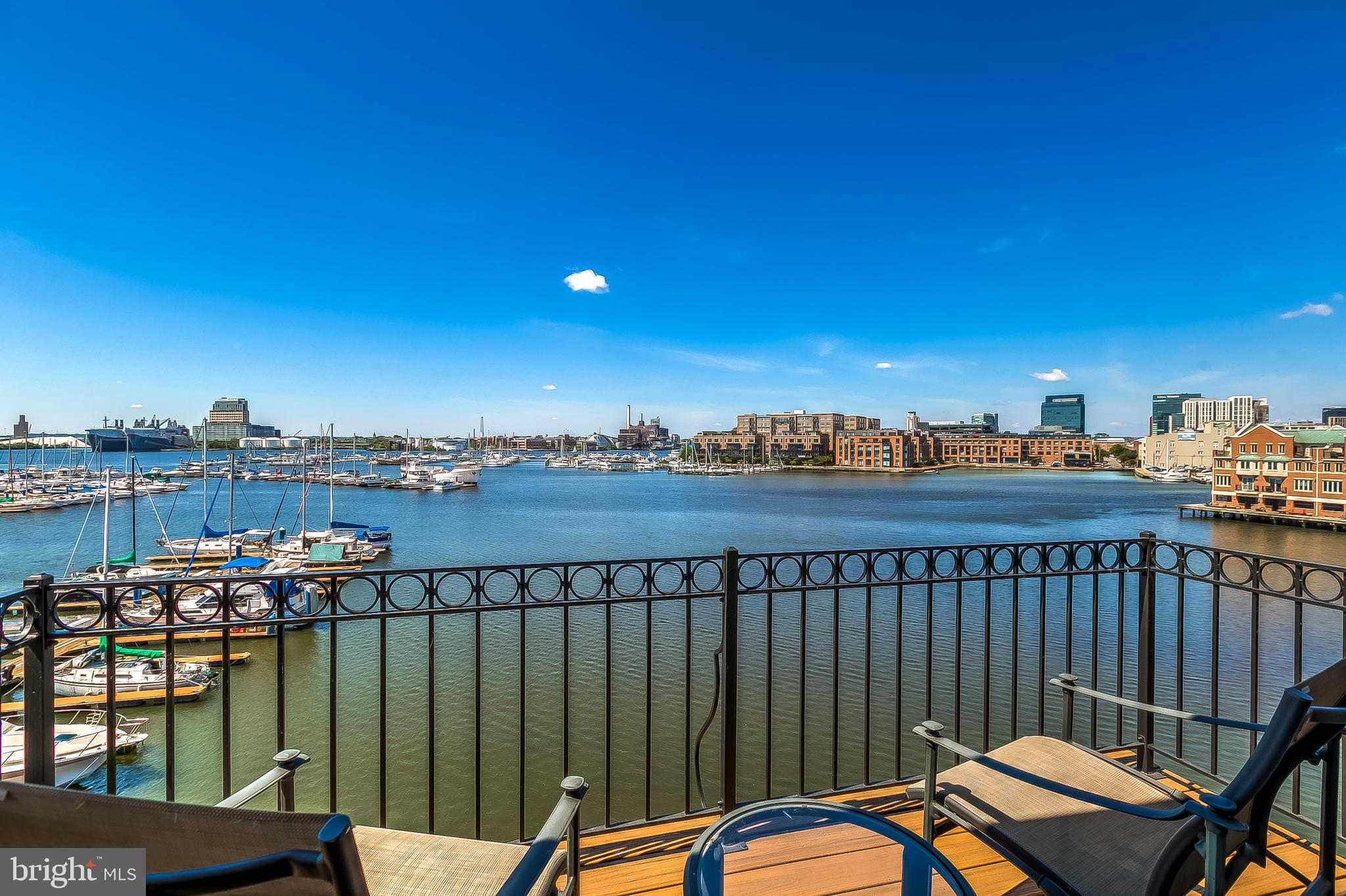 Magnificent waterfront home in Canton. North Shore's finest residence offering sweeping views of the harbor, Fells Point, Canton marina and beyond.  Four floors of unprecedented luxury.  End of group townhouse condominium with windows on three sides.  Enormous light filled rooms complete with custom millwork, high-end appliances and fixtures and a remarkably livable floorplan.  The master suite encompasses the entire fourth floor of this 4000+ sq ft residence and incorporates a spacious bath, large walk-in closet, vaulted ceilings, fireplace and waterfront balcony. The two car garage is complemented by two additional parking spaces next to the home and additional space behind the garage accommodating a total of five vehicles.  Incredibly convenient location in the heart of Canton and minutes away from Fells Point and Johns Hopkins Hospital.  This is downtown living at its finest.