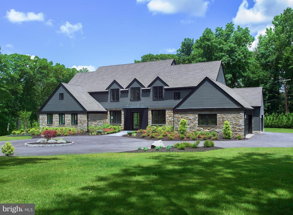 Located at the gateway to Rock Creek Rd & Saunders Woods, this new construction showplace was conceived by architect FL Bissinger, and blends sleek transitional-style architecture with ultra-high-end features & finishes.  Completely on-trend, this modern 4 bedroom + office, 4.5 bath home is positioned on a beautifully landscaped one-acre lot, and offers expansive, exquisitely-appointed living spaces. A rear grey paver-stone patio is ideal for enjoying the outdoors, and large level landscaped grounds lined with trees for privacy is where the kids & pets can play. Making a striking impression on the exterior is a circular drive proceeding to a 3-car attached garage, clean modern rooflines, beautiful stone with Hardie plank siding, bold black window trim, and a custom Lowenstern metal front door with metal & glass canopy flanked by Matte black shutters. Contemporary interiors are also artfully designed, featuring airy 11~ ceilings & a fabulous open floorplan built for entertaining. Luxury is embodied in every detail, with the finest elements throughout including 7~ white oak wood flooring, custom solid wood-stained and aluminum drawer cabinetry, solid 8~ wood doors with groove detail & Omnia stainless steel hardware, recessed LEDs with a Lutron Lighting System, quartz countertops, premium Kohler fixtures, and the list goes on. Further enhancing the ambience are abundant Sierra Pacific windows with Low-E glass bathing the home in natural light. Highlights of the dramatic main level are an architectural staircase with stainless bar railing system off the foyer, gracious dining area with circular inlaid ceiling, elegant living room/study, custom kitchen with open breakfast & family room creating an amazing flow. The chef~s kitchen is a knockout, equipped with white quartz countertops & 12~ waterfall island, Porcelanosa backsplash tile, top-of-the-line Miele appliances including a touch-panel refrigerator and freezer, large pantry & wet bar area with Miele wine cooler. Gather & relax in the fabulous open family room centered by a linear gas fireplace with floor-to-ceiling slate surround, built-in TV area & shelving/cabinetry with a custom-textured glass backsplash. A massive window wall stretching from the kitchen showcases gorgeous views & has 2 sets of double glass doors leading out to the terrace. Refresh & renew in the sun-filled master retreat featuring a sitting area, 50~ electric/gas fireplace, outfitted display for TV, his/her walk-in closets & deluxe spa bath clad in Porcelanosa tile & heated marble floor. An extensive wall-hung vanity with dual sinks, custom mirror sconces, over sizedsoaking tub, frameless glass shower with rainfall head & separate toilet area complete the luxurious experience. Also on this level is an office, powder room, full laundry room & mudroom to the garage. The second-floor includes three additional bedrooms with upscale en-suite bathrooms and walk-in closets. The generous lower level with under-stair storage plus extra storage in the mechanical room provides a perfect hangout with recreation & media areas. There is 3-zone HVAC, Nest thermostats, 2 tank-less water heaters, French drains, a wired security system & Cat 5 for speakers. The premium location is convenient to the Gladwyne Village, Gladwyne & Saunders Parks, award-winning schools and all major transportation routes.
