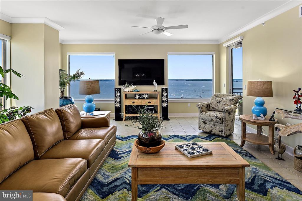 When only the best will do, welcome to residence 1501 at the Gateway Grand.  Spectacular panoramic views of the Atlantic Ocean, Ocean City, and Assawoman Bay from not just one, but two balconies.  In the distance views as far South as Assateaque Island National Seashore and North to Bethany Beach, DE.  Every room has direct access to one of the outdoor balconies.  Owner Upgrades include custom electronic blinds in the great room and owner's suite, hard wired high-end speakers inside and outside, custom tile floors in the bedrooms, an upgraded wine fridge in the kitchen, and the installation of comfort height commodes.  In addition, a smart home system allows for lighting and thermostats to be controlled remotely.   You will notice the attention to detail as there are custom closet organizers in the master bedroom and custom shelving and lighting in the laundry room.  This is a must see property in one of the nicest high rise communities in Ocean City.  Call for your private showing today!  Deeded storage locker #6 on ground floor included with sale.