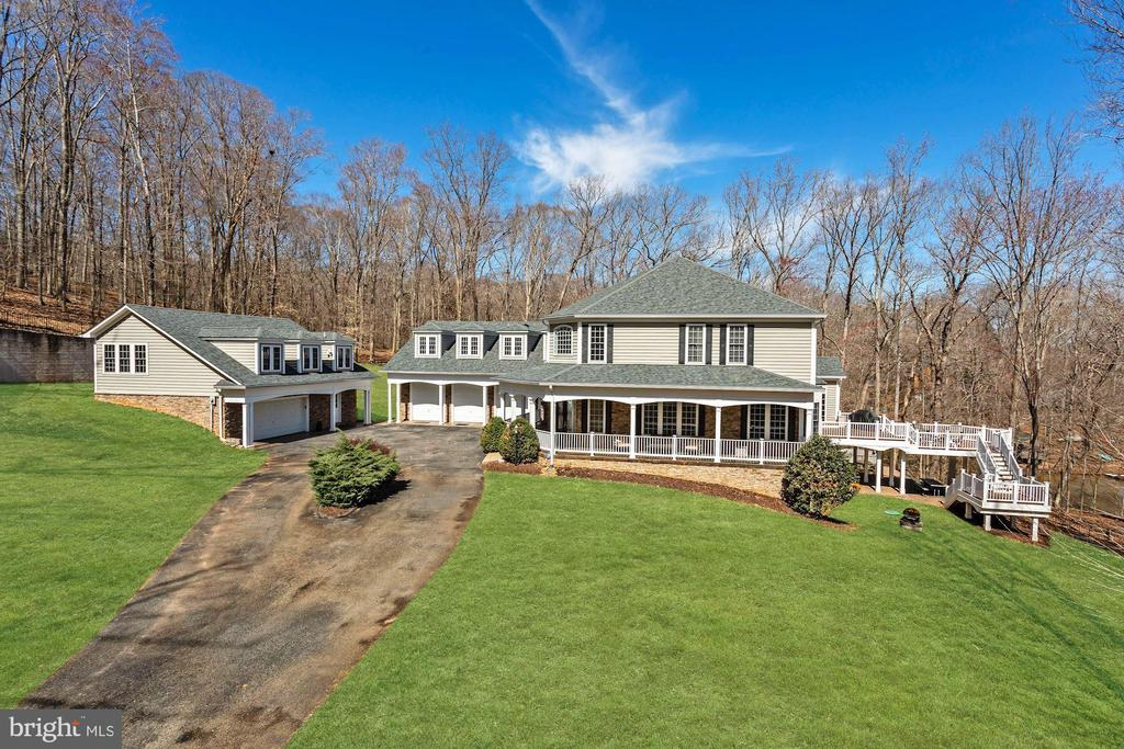 AMAZING WATERFRONT ON THE OCCOQUAN WITH DOCK, 5 CAR GARAGE ON OVER 5 ACRES***ALMOST 8600 SQUARE FEET***CUSTOM BUILT WITH GORGEOUS FEATURES, MARBLE COFFERED CEILINGS, HUGE DECK, PATIO WITH WONDERFUL VIEWS ACROSS THE WATER***A PERFECT 10!***CONFERENCE RETREAT OR HOME OFFICE OVER ADDITIONAL GARAGE -GREAT FOR HOME BASED BUSINESS***MULTI LEVEL DECK AND PATIO, PRIVACY & SERENITY***UP TO 10 HP BOATS ALLOWED ON OCCOQUAN RESERVOIR WHICH RUNS FOR FILES...TONS OF FISH, WILDLIFE***HIDDEN CLOSET ENTRY TO ADDITIONAL ROOM**LARGE WALKOUT BASEMENT WITH BAR AND ADDITIONAL ROOMS - A MUST SEE!!!!
