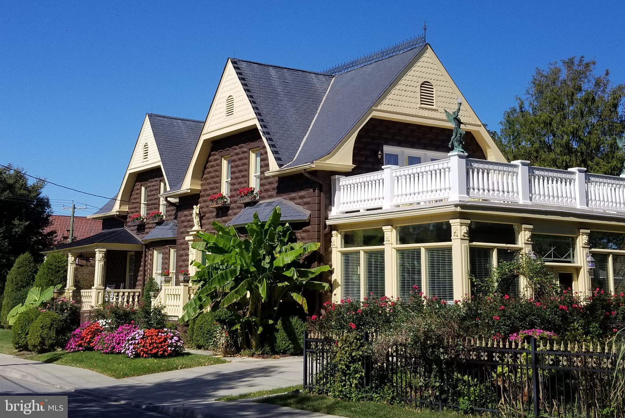 Beautifully maintained home in the heart of downtown Lewes.  Just steps away from all the shops and restaurants in this charming coastal town.  This 5 bedroom, 4.5 bath home located on the corner of Franklin and Kings Highway is a real treasure.  Inside you will find crown molding, ceiling medallions, wainscoting, double hung windows, hardwood and tile flooring, breathtaking chandeliers and more!!  The kitchen has two sinks, garbage disposal, gas stovetop and oven, quartz countertops, built in fridge, and a kitchen island.  There is a formal dining room and an all season sun porch overlooking the koi pond and fountain.  On the second floor is a large master bedroom which opens up to a large deck overlooking the backyard as well as 3 more large bedrooms.  Downstairs you will find a finished basement complete with bar, viewing area, and a full bathroom.  There is also additional storage in the unfinished basement.  This is a home you definitely will want to see today!