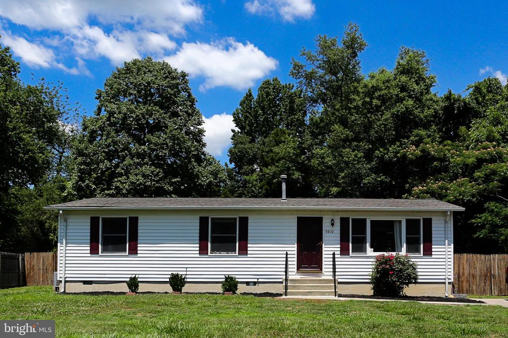 Cute Rambler with 3 bedrooms and 2 full baths on fully fenced .42 acres with storage shed and playhouse/shed with electric and new deck. Move in ready.  Close to Rt 301;  7 miles from King George Walmart and shopping, dining;