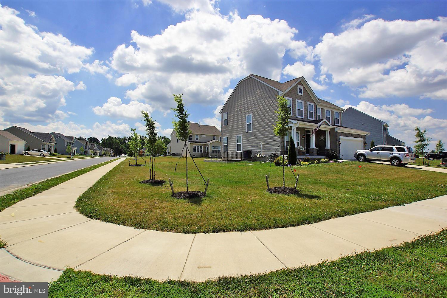 Upgrades Galore! Finished basement! If you have ever dreamed of owning a model home this is your opportunity! This home has a full front porch, stone front, custom siding on a corner lot. As you enter the home you will feel like you are entering a model home with all of the upgrades. The first floor features beautiful gleaming LVT flooring, open gourmet kitchen, with large island, morning room and oversized family room and office/playroom. Transition upstairs and you will find a very large master with walk in closet, tiled bath, 3 additional bedrooms and a full laundry room. The basement is complete with bar, full bath large great room, game room, sliding door to walk out stairs and egress windows. This home is a must see and all located in the desirable Caesar Rodney School District! Put this on your next tour.