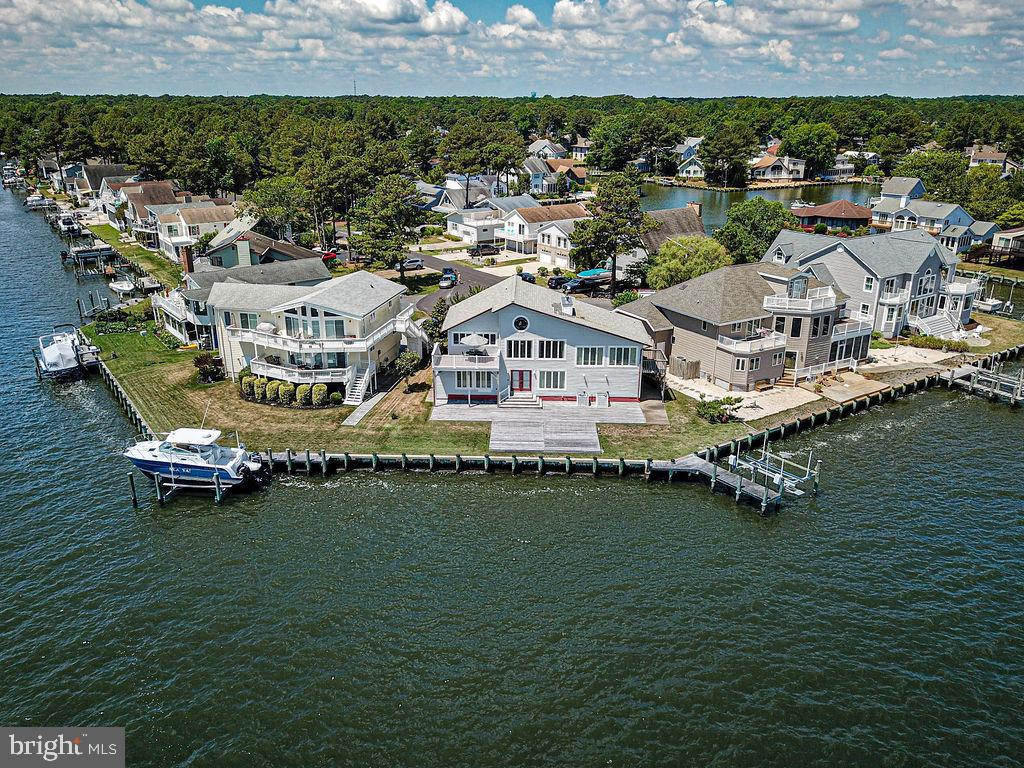 A MILLION DOLLAR VIEW PRICED TO SELL! Breathtaking Direct Bay Front with Panoramic Views Home in Ocean Pines, MD is ready for your immediate summer enjoyment. Once you enter this 3 bedroom 2.5 bath home you are truly amazed by the spectacular bay views from every window!  Greeted by soaring ceilings as you enter into the second level great room and chef style kitchen!  Entertain family and friends on the outside over sized Bay front Trek Deck or large Eat in Kitchen complete with granite counters, cabinetry with pull outs and newer appliances. Relax in an expansive Bay front Master Suite with panoramic views and private side door entrance!  The first floor boasts a large family room, mini kitchen, 2 bedrooms, one full bath and laundry. Exit out to a double deck as you walk out to your 115 feet of bulkhead and dock with boat deck and a private outdoor shower on side of home. Other exceptional features include  two Crafted German wood/coal stoves,   two stain glass windows,  Custom exposed wood beams,  outdoor shower, newer roof, newer windows, newer furnace and new bulkhead,  , encapsulated  crawl space and 2 car garage! Long concrete driveway at the end of cul de sac is perfect location for privacy. This home replace heat and air condition and new furnace in August on 2nd floor and 1st floor unit was replaced 2 years ago.  Don't miss out on this captivating home.  ~ schedule your showing before it is gone!