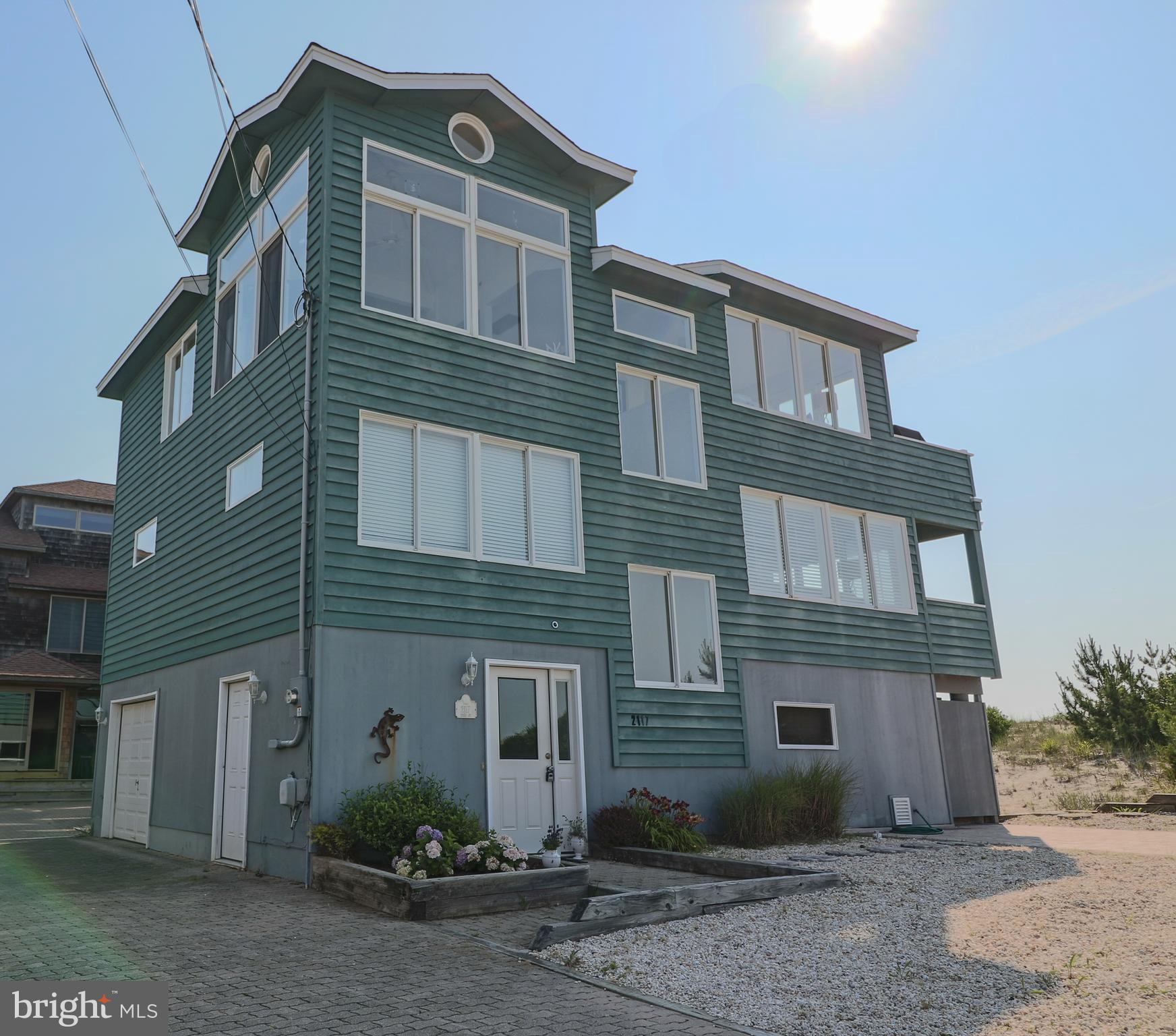 LOOK NO MORE, LBI Oceanfront! Custom built ocean front property with the most AMAZING VIEWS. Move in Ready, reversed living home, featuring 4 bedrooms, 2 full bathrooms and 2 half baths. Main living area features wrap around windows, optimizing the ocean and bay views. Kitchen has recently been updated with stainless steel appliances, granite counter tops and breakfast bar. Enjoy the morning sunrises from the master suite with sliders leading to an over size deck. First level features a second living area with FULL OCEAN VIEWS plus a spacious bedroom with ocean views and deck access. There are two additional bedrooms and a laundry room on this level. The ground level has been completely finished to entertain, providing an additional 900 sq ft of living space. So many features through out this home....newer furnace and air condition units ,central vacuum, new roof, security system, wood burning fireplace, ceiling fans and recessed lighting. Roof top deck was built to support a hot tub, electric  is in place.  Attached 10 X 10 storage area.