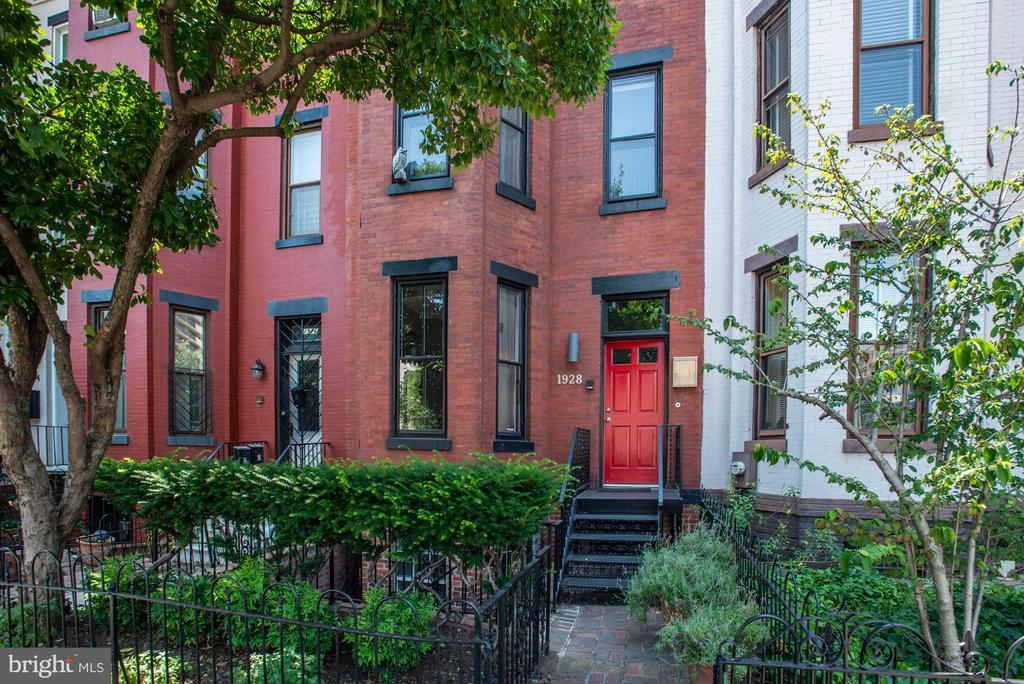 Welcome to 1928 15th St NW, a spacious row home with contemporary flair on a wide one-way street in the U Street Corridor. Showcasing 6 Bedrooms and 3.5 Baths throughout 4 finished floors, this attractive property has a coveted In-Law Suite with 2 separate entrances. The Main Level welcomes you with a vestibule that is complete with eye-catching tile work. Soaring ceilings and hardwood floors highlight the open floor plan. The Living Room is warmed by a wood-burning fireplace that is flanked by built-in bookcases and accented by a beautiful bay window. The Living Room flows into a separate Dining Area. The sun-filled Kitchen is comprised of ample cabinet space, granite counters, a Breakfast Bar, and access to the Rear Deck that overlooks the Patio and Off-Street Parking.There are 5 Bedrooms and 2 Full Baths sequestered on the two Upper Levels. The private Lower Level Apartment is accessible by way of the separate front entrance and features a Living Area, Full Kitchen, Bedroom, and Full Bath. The U Street Corridor is a lively and hip neighborhood of Northwest DC, showcasing an eclectic mix of eateries, entertainment venues, and boutique shops. Spanning just a few city blocks, the number of restaurants, retail, and other amenities is impressive and offers its residents and visitors a new daily experience. Living in the U Street Corridor makes travel to other parts of the city easy and convenient. Exploring the nearby neighborhoods of Columbia Heights, LeDroit Park, Shaw, Logan Circle, Dupont Circle, and Adams Morgan is just a short walk or ride away. Access to all parts of the city is simple with the U Street and Shaw-Howard Metro stations nearby plus various bus lines, ZipCar locations, and Capital Bikeshare stations.Just north of the U Street Corridor is Meridian Hill Park, a 12-acre multi-faceted public outdoor space that encompasses a large lawn, terraces, historic statues, and its famous 13-basin cascading fountain. Dog lovers and outdoor enthusiasts pace the pa