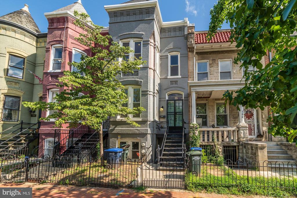 Within walking distance of the Capitol and just a block away from the hip H Street Corridor, 704 G Street is a charming, fully renovated three bedroom, 3.5 bathroom Victorian rowhouse that still retains historic touches. The main level features oak hardwood floors, airy 10-foot high ceilings, recessed lighting and a unique reuse of historic pocket doors to conceal a cleverly built TV and entertainment nook. The kitchen is beautiful and packed with modern and luxurious amenities including honed-finish stone countertops, subway tile backsplash, five-burner gas range with hood and white Shaker-style cabinets with matte black pulls. All appliances are made by Samsung and are stainless steel. There is also powder room tucked away in a corner on the main level. The upper floor features a skylight that illuminates the home with natural light. Doing laundry is easy with washer and dryer hidden in a closet between the two bedrooms. The owner's bedroom suite welcomes you with an abundance of natural lighting from the bay window. The luxurious en-suite bathroom touts a beautiful, frameless glass shower divider, over-sized vanity and skylight. The second bedroom suite has a large closet and a private ceramic tile bath. The lower level is the icing on the cake with a second kitchen, third bedroom, a large full-bath with floor-to-ceiling ceramic tile wainscoting, clawfoot tub, a second washer/dryer and access to the rear. The rear courtyard is fully-fenced with access to the main alley through a horse-walk. This ideal location is literally steps from the H Street Corridor, boasts a 97 Walker's Paradise Walkscore and a 99 Biker's Paradise Score. Walk to all the hot bars, restaurants and shops on H Street, and the new Streetcar which takes you right to Union Station, which is just a few blocks away anyways. This location is second to none!