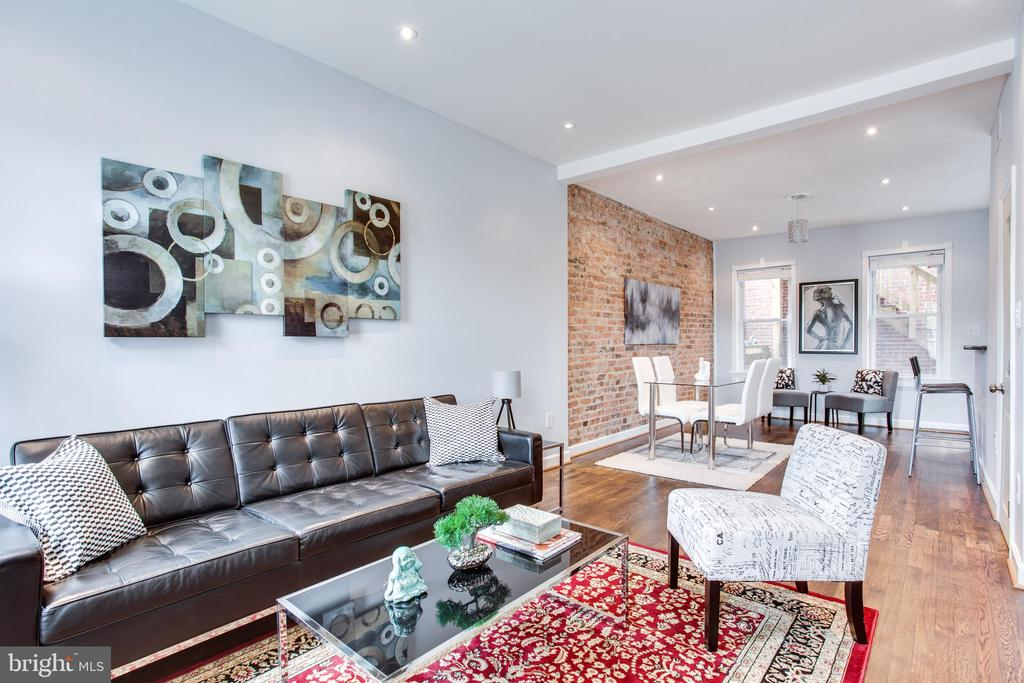 Spacious Rowhouse in Columbia heights. Newly renovated open floor plan, 4 Bedrooms 3.5 Baths, walkout basement, back patio, balcony and a spacious rooftop deck.  Steps from Restaurants and nightlife.  Blocks from Petworth Metro and Columbia Heights Metro.