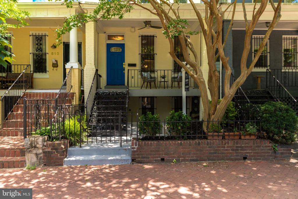 OFFERS, IF ANY, DUE TUESDAY 7/21 AT 3PM. Welcome to 611 4th St, NE where contemporary style meets classic Capitol Hill charm. Original and well-maintained wood detail throughout make this a must see. Enjoy plenty of outdoor space in one of the most charming neighborhoods in the city. The shaded front porch, with ceiling fan, plus a two-level rear deck and backyard/garden provide for a quiet retreat. Convenient GARAGE PARKING and bonus lower level English Basement with C of O add value to this stunning home. Entering the main level living space there is a beautifully framed wood-burning fireplace with mantle, high ceilings, and massive windows providing an abundance of natural light. The dining room is perfect for entertaining and flows into the gourmet kitchen. The renovated kitchen includes an exposed brick wall, breakfast bar, gas cooking, stainless steel appliances, granite counters and a closet with a washer and dryer. A convenient half bath completes the first floor of this home. The rear yard has been recently landscaped to include cherry and stone fruit trees, planter boxes, and a multitude of flowering plants. Grow raspberries, strawberries, tomatoes, peppers and more! The second level is complete with 3 spacious bedrooms including a master bedroom with a vaulted ceiling and multiple closets, a covered deck and 1 full bath. Each bedroom includes a closet and large window for storage and light. Wonderful original details include hardwood floors, wood banister, oversized newer windows, high ceilings, and original pine wood floors on the second level. Upgrades include: fresh paint throughout, recessed lighting, nest thermostat/carbon monoxide detectors, nest security system and cameras. Lower level English Basement has a full kitchen, washer/dryer, living area and one bedroom with front and rear entrance. Conveniently located a few short blocks to Union Station, Whole Foods, Giant, Union Kitchen Grocery, Stanton Park, and some of the best shops and dining in th