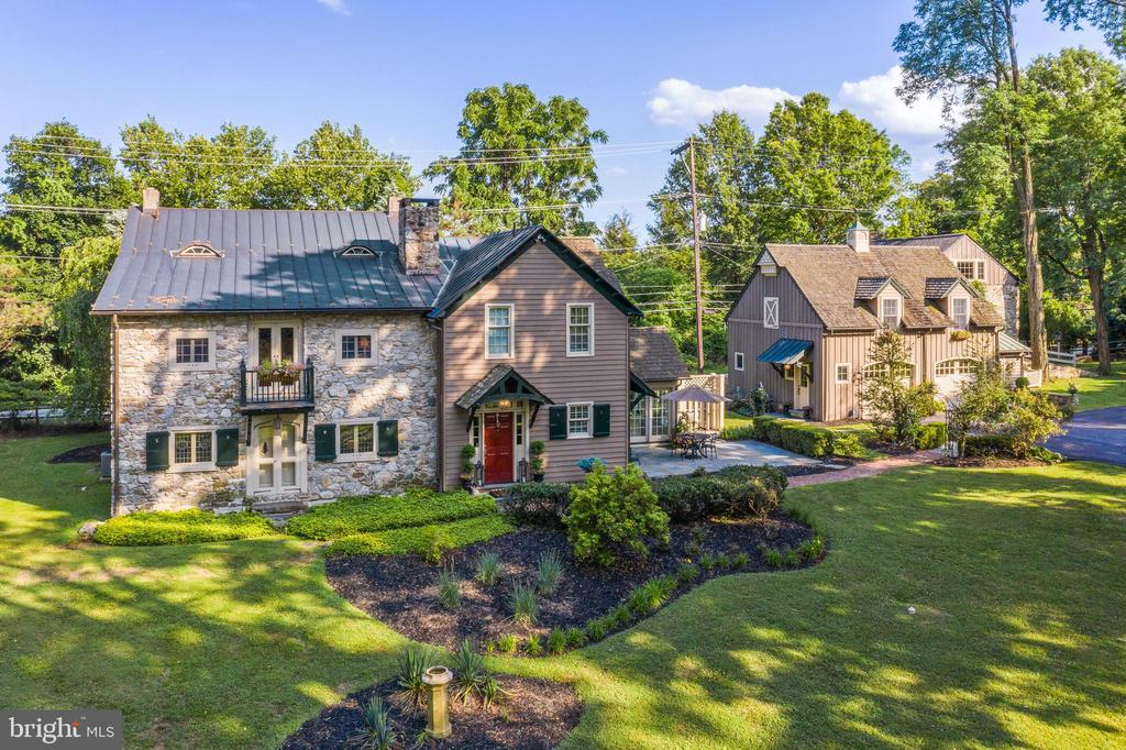 "Presenting ""Les Petits Bois""-a sophisticated historic farmhouse with a European flair that has been meticulously expanded and updated over the centuries. The original home is believed to date prior to the 1730's. In the 1800's a French professor created the first enchanting addition while Peter Zimmerman Architects seamlessly blended the most recent elegant addition in the mid 1990's. Delightfully poised on 3.7 lush and serene acres, this property also offers a spectacular Guest House, a Pool surrounded by slate patio, Pool Cabana, English Greenhouse, over-sized 2 car garage, Potting Shed and the original Barn which is ideal for all of your storage needs. This 4-5 Bedroom, 3.5 Bathroom masterpiece offers today's Buyers the amenities they desire while retaining the authenticity and character seldom found in present times. Inside the main home, discover restored and original random width hardwood flooring, walls with exposed stone, original hardware, hand hewn ceiling beams, an impressive walk-in stone fireplace, stained glass lead windows, 2 staircases, great closet space, terrific flow and so much more. The first floor includes a light filled gourmet Kitchen with a Breakfast Room surrounded by expansive windows, an adjacent Dining Room with original period antique corner cupboards, a generous sized Great Room with an incredible stone wood burning fireplace, an Office with a wet bar and fireplace, a graceful Entry Foyer, Powder Room and a convenient Mud Room with cubbies.  Up the main stairs, with an entire wall of exposed original stone, the beautiful Primary Suite includes a cathedral ceiling with beams, a cheerful Bath and a large walk-in closet. Two additional Bedrooms, one was the former master bedroom with walk in closet and the other is currently used as a 2nd floor Den, a lovely large Jack n Jill Bath with shower and tub and the Laundry complete this level. The Third floor offers another wonderful Bedroom with office space and a large walk-in closet.  Additionally, the Guest House is a complete  WOW  boasting another home Office, fantastic Entertainment Space, an impressive Kitchen and Great Room with exposed stone walls and a gas fireplace, a full Bath and loft Bedroom. Such distinct features are well suited for remote working as well as hosting extended family and guests. This very special estate, located on a cul-de-sac street, is in a highly convenient location with close proximity to the Paoli  Amtrak Train Station, slip ramp to the PA Turnpike, Corporate Centers, King of Prussia, Wegmans and all of the fine dining, shopping , boutiques and recreational outlets in the greater Main Line and Chester County areas. The highly rated Great Valley school district is a plus as well as easy access to numerous private and independent schooling options. This significant gem of a property will continue to be loved and treasured for years to come! Please enjoy the video tour using the camcorder link above."