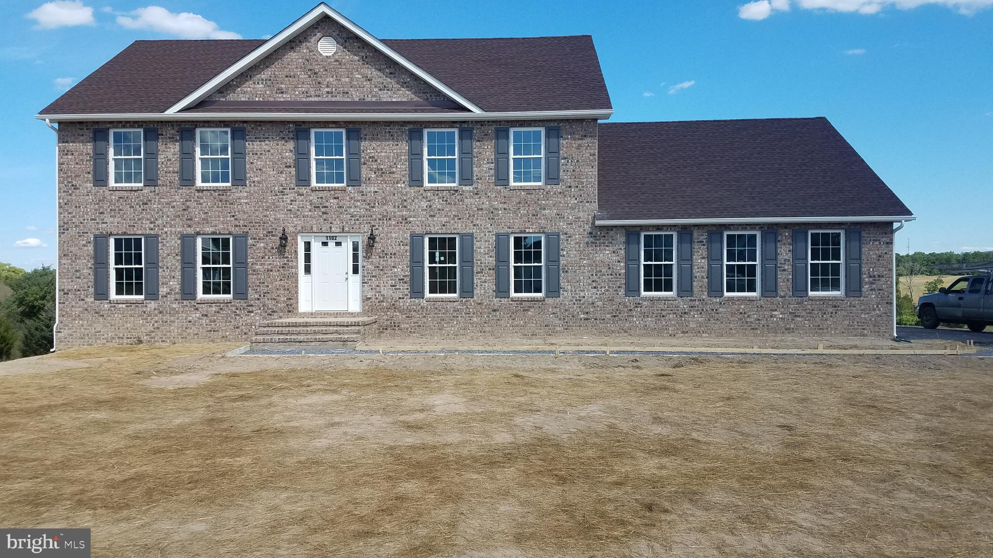 New Construction under way on 1 acre lot that backs to Golf Course.  Beautiful brick front colonial with approx. 2,800 finished sq ft and a full unfinished walkout basement with a large deck or patio.  Open floor plan with large kitchen peninsula overlooking family room with lots of windows. Kitchen will have granite counter tops and stainless steel appliances.  Hardwood floors throughout the main level which includes a formal dining room, living room, family room, bathroom and laundry room.  Very large master bedroom with large luxury bathroom that includes ceramic tile and over sized soaking tub.  All bedrooms have large closets. Community is located near I66, shopping, restaurants, wineries and breweries.  There are several golf courses within 5 miles. No HOA fee!