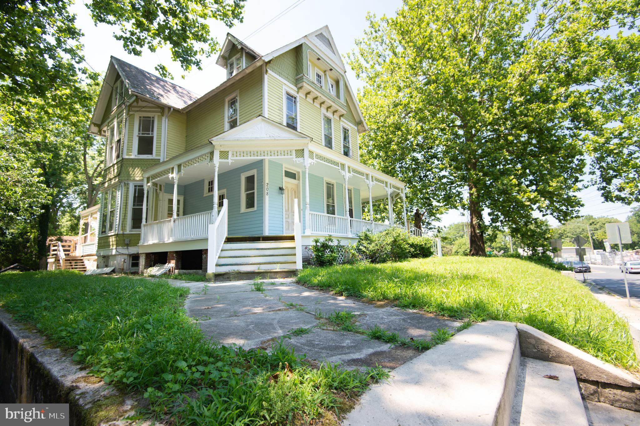 This Victorian could be a showplace with the right attention!  It is sited on large lot with ample parking.  Features include a wrap porch, original wood work, 3 sets of pocket doors.  She is waiting for the right person to bring her back to her original beauty!