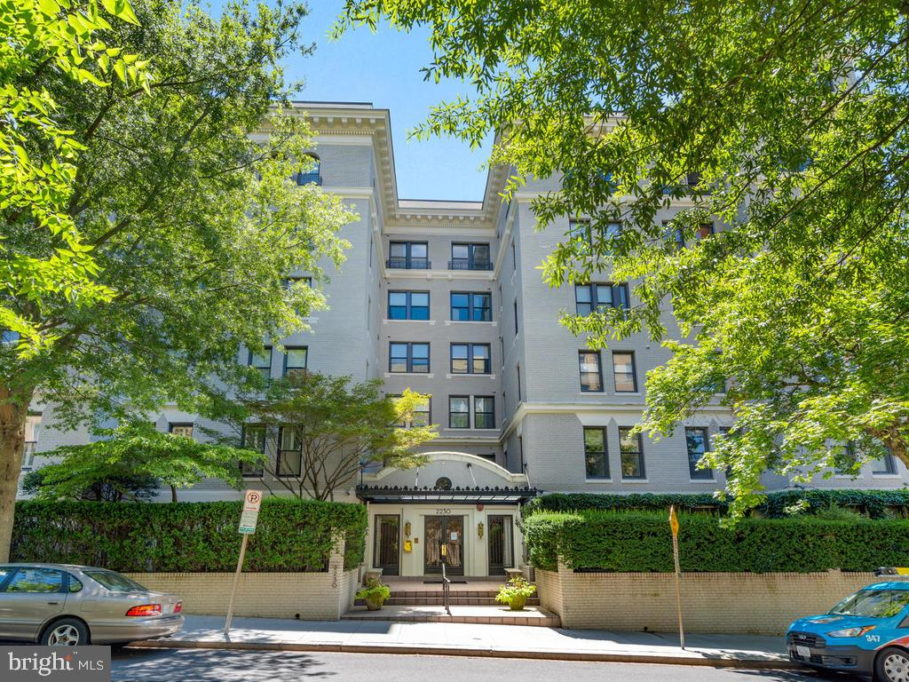This delightfully updated, light-filled, and spacious condo in one of D.C.'s most coveted buildings is now for sale. Unit 4CW, offers both modern and classic styling in a semi-open layout. With 1,420 square feet of living space, high ceilings, and a full-size balcony, theres plenty to enjoy. The master bedroom with balcony provides an en-suite, spa-like marble bath with double vanities plus incredible storage and counter space. The guest bedroom is nearly as large and has a custom closet system. Some features include: newer windows, hardwood floors throughout, central air conditioning, in-unit laundry closet, pre-installed speaker system, and built-in shelving and display niches. One reserved parking space and one large extra storage closet are included. The building has a recently renovated fitness room with sauna.What is particularly appealing about the St. Nicholas is that it offers all the benefits of living in D.C.'s most prominent Kalorama neighborhood in a quiet setting and at a very attractive price. Within walking distance, one can easily reach the Sunday Dupont Farmers Market, Woodley and Dupont Metro Stations, hiking and running trails of Rock Creek Park, and all sorts of city amenities.