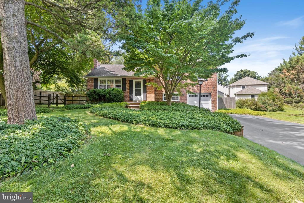 With the first floor interior walls removed, this pretty home in the sought-after Spencer/Landsende Devon neighborhood has the open, spacious LR/DR/Kitchen interior space that many of today's buyers prefer. Buyers will also love the beautiful  new (2018) kitchen with white cabinets, quartz counters, island with seating,  tile backsplash, stainless appliances including a fabulous Viking gas range and Kitchen Aid refrigerator, newly added and refinished 1st floor HW floors (2018), the newer sliding glass door to the backyard (2018) and gas FP (2012) with new mantel (2018).   The second floor is home to three nicely-sized BR's with HW floor, a full hall bath and a  MBR half-bath;  the lower level offers flex space for a Family Room/Office/Playroom with tile floor and adjoins the laundry room with an outside entrance to backyard and an entrance to the 1-car attached garage as well.  Finally, there's a newly installed door from the FR to the unfinished basement which, when finished, would add another 616 livable square feet to this charming home!  A peaceful respite is the lovely, private backyard which is entirely fenced (some shared with the neighbor) and has a newer composite deck with a retractable awning offering nice shade during these hot summer days, and a small patio area perfect for the grill.  There is also a shed for all those landscaping tools which saves the garage for the car.  There are additional amenities/updates including newer A/C (2011), all windows (2008), garage door (2010), interior doors (2013), two storm doors (2018),  basement waterproofing, sump pump and dry well (2019) and new circuit box and grounding rods & outlets added (2014).  Don't let the age of the gas furnace concern you either - it's a beast and has performed really well all these years as the owner's HVAC vendor tells them every year when it's serviced!   This well-maintained, updated home's location in a top school district,  conveniently close to schools,  library, shopping, trai
