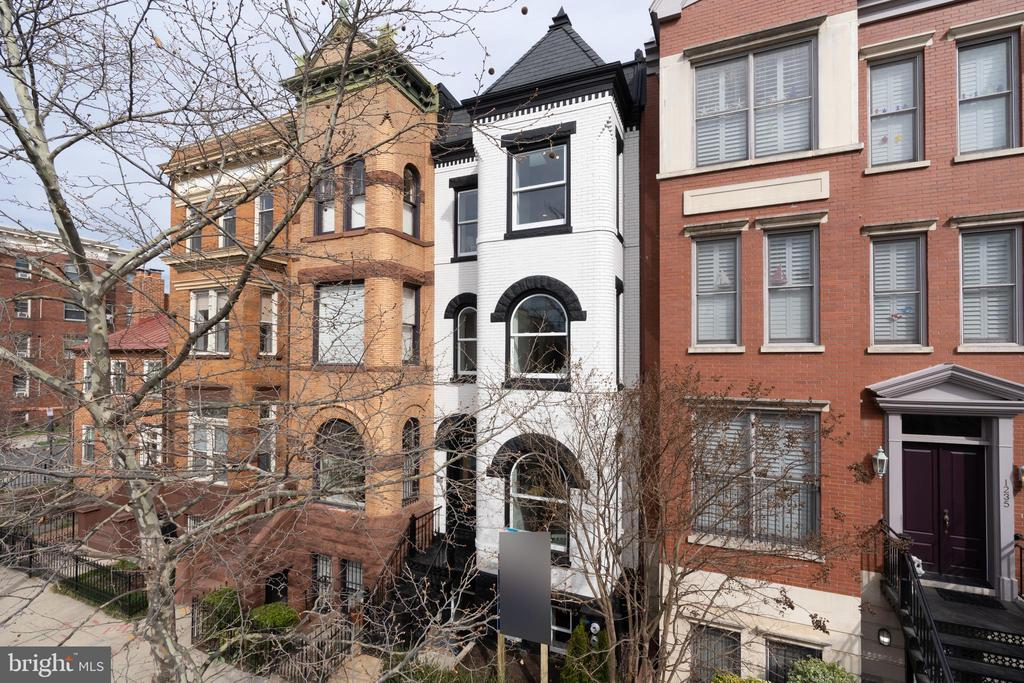 Luxurious, thoughtful, and well built, top to bottom. Custom 3 bedroom, 3.5 bath, 2,125 sf, outdoor space that is perfect for July 4th entertaining, fully renovated smart home in a historic, two-unit building in Logan Circle/Shaw. Spacious and perfect for entertaining, no detail is missed here. The design blends the historic character of this Grand Dame row house with all the technology and features of modern-day living. The chef~s kitchen has custom cabinets, marble counters, and Bertazzoni appliances. The light-filled living room opens through a glass wall to a gracious deck and a large, completely private back yard. The unit has two master suites, both with multiple closets and bathrooms that rival the best luxury hotels ~ complete with custom double vanities, separate water closet, spacious showers, and heated floors. The third bedroom also has its own ensuite bath, water closet with a soaking tub. Hansgrohe, Kohler and Toto fixtures throughout. This smart home can all be controlled via your phone, from the hard-wired security and in-ceiling sound systems, to the heating, cooling, and hot water systems. Even the door locks are included in the smart system. The home is also incredibly efficient, with dual flush toilets, high efficiency HVAC and hot water systems, all new windows, and insulation systems that meet the next generation DC green energy requirements. Classic, modern design meets gorgeous detailing. With its immediate proximity to Blagden Alley, this one of a kind home is waiting for you.