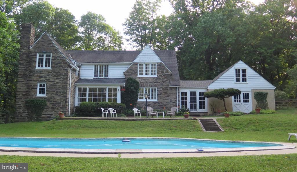 This is a rare property bought by the present family in 1955, the potential of which is extraordinary. This is truly a once-in-a-lifetime opportunity for the buyer who demands a very special location, a unique home and has the vision to create a masterpiece for their lifestyle.  Unique and utterly enchanting 110 year old, 2 story carriage home with pool.  Positioned on a private 2.56 acre lot, surrounded by mature landscaping, this 3+ bed 1 1/2 bath residence was built on the grounds of Dolobran a grand estate.  The property has a twin tenant house which is 1 structure with 2 living quarters (both with valid rental licenses) and a barn ruin.  You can either embrace history and work with existing structures OR build new compound on fabulous lot.  Must see to appreciate.