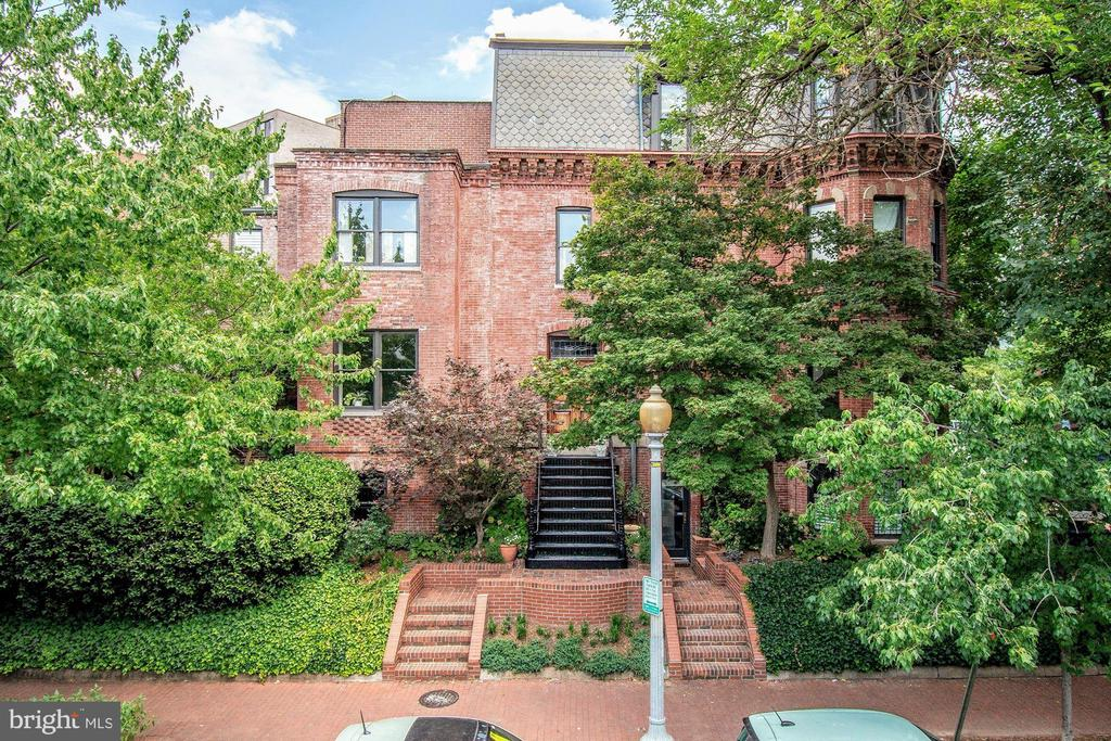 JUST LISTED in prime west Dupont Circle! Fabulous 4-level semi-detached townhome built circa 1877. Full of natural light from three exposures on unique corner lot with GARAGE!  Stay Home comfortably in this rare urban oasis featuring large, secluded multi-level garden and ROOF DECK / terrace spaces walking out from Main  and lower Entry Levels. Nearly 3,000 SF of finished living space includes 3 Bedrooms, 3.5 Bathrooms, 3 fireplaces, stylish Kitchen, Wet Bar adjacent to outdoor space, oversized double windows, and charming vistas from each level of the turret. Leave the car in the Garage with a 98 WalkScore and Metro less than 2-blocks away. Stunning home in an Amazing location! Must See!