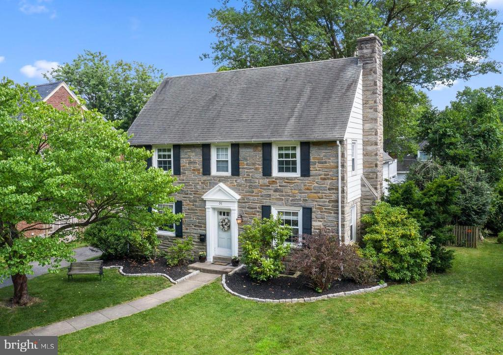 Check out the 3D virtual walk through tour! Here is the home you have been waiting for in sought-after Merion Golf Manor! This classic stone colonial has been lovingly maintained and updated. A center hall entry welcomes guest into a spacious formal living room to the right, and a dining room to the left, both which feature original hardwood floors that extend upstairs and through all 2nd floor bedrooms. Beyond the dining room is a brand-new kitchen featuring stylish cabinetry, new quartz counter tops, and new LVP flooring. A breakfast room addition with skylight creates an open and sunlit space great for everyday living and entertaining.  Off the breakfast room is the family room and powder room. On the second level you will find an inviting master bedroom and en-suite bath with glass enclosed shower, three additional bedrooms and an updated hall bath with tub. A lovely porch is accessed from the rear bedroom and overlooks the backyard. The finished 3rd level, currently used as a 5th bedroom, could also be used as a playroom or office. There is a large storage room on this level which could easily be finished for extra living space if desired. Completing the interior is the finished lower level with easy to clean tile flooring, wainscoting, and a storage/laundry room. Enjoy peace of mind with replacement windows and blinds throughout, newer HVAC (2016), a new hot water heater (April 2020), a sump pump and French drain, and a new sewer main from the house to street. Entertain inside and out easily, accessing the backyard from steps leading out of the breakfast room. The rear paver patio and stone walls compliment the fenced-in flat yard which was professionally landscaped to maximize all available backyard space. The garage currently used for storage could easily be used as a one car garage by future owners. Life in the Manor offers a convenient suburban lifestyle with a quick commute to the city. Choose from the award-winning Haverford Schools including Coopertown 