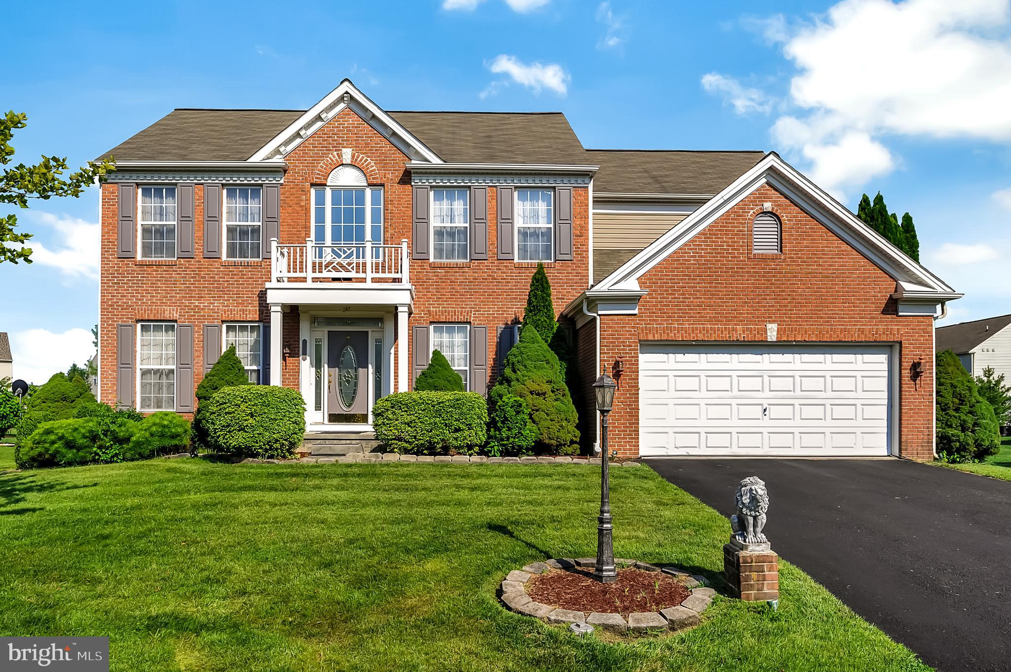 This traditional brick Colonial boasts mature landscaping and a handsome exterior that aims to please the most discriminating buyer. Once inside the two level foyer will wow you and your guests. Light and bright with a split staircase with catwalk at top looking down over the entryway. To your left is the formal living room with a picture window and fireplace. The dining area is perfect for entertaining, located between the formal living room and kitchen. The cook's kitchen features plentiful wood cabinets and endless prep space between the countertops plus the large island. Shiny hardwood floors enhance the design of this space. The island is perfect for a snack or quick meal and has room for four to sit at it. Off the kitchen is a large eating area with chandelier and sliding doors to the back patio. Beyond the kitchen and eating area is the large family room with another fireplace and a wall of windows to show off your gorgeous backyard. Retreat upstairs to your luxurious master suite! The en suite bathroom is spa-quality with a soaking tub, walk-in shower, and large vanity. The other three bedrooms feature wall-to-wall carpeting, ceiling fans, large closets and multiple windows for natural light. They all share a hallway bathroom with a tiled tub/shower combo and large vanity with plenty of room for storing all the essentials. The laundry room is conveniently located on the second floor too, complete with built-in storage space! There is additional space in the separate office, perfect for working from home or eLearning! Out back you have your own personal oasis with the brick paver patio complete with sunshade for those hot summer days. The yard is expansive and lined with a wall of mature trees for your privacy. Enjoy keeping your grounds gorgeous year round and saving money on your utility bills with the custom sprinkler system and private well! Click the link to take a virtual tour: https://bit.ly/3fS38c6