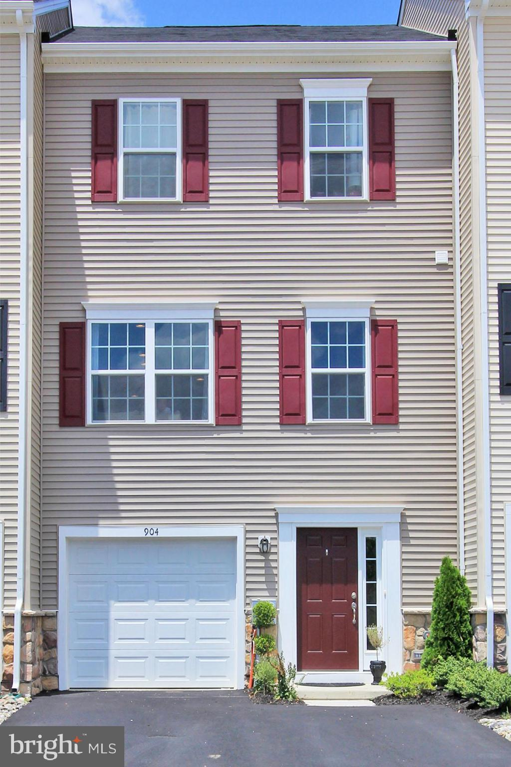 JUST LIKE NEW! MINT CONDITION! Numerous upgrades have been added including the three story bump out giving you additional room on all levels. Enter the foyer to beautiful hardwood flooring leading to the den with sliders and enjoy the backyard summer parties. The main level has a spectacular open floor plan, fantastic for entertaining family and friends. The chef of the home will enjoy preparing meals in the gourmet kitchen having a large center island with classic granite countertops, 42~ cabinets, recessed lighting, and stainless steel appliances.   The upper level offers a large Master bedroom with recessed lighting, master bathroom, along with two additional bedrooms and a hall bath. Conveniently located to the interstate. Better than new and without the 6 month wait!
