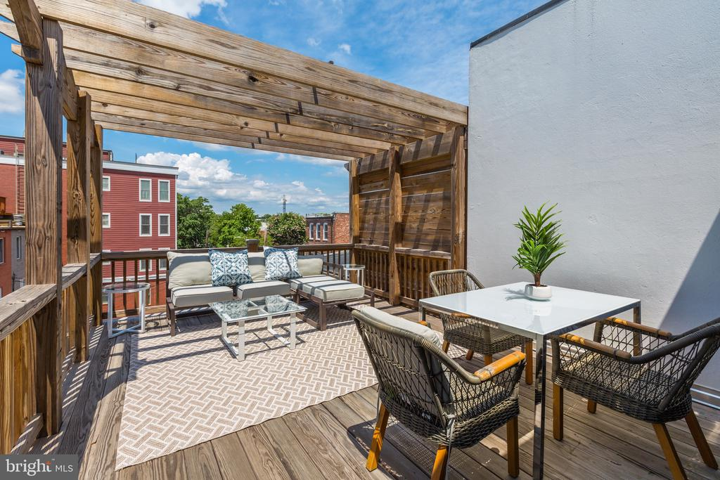Meticulously renovated and converted in 2017, this stunning painted brick Italianate residence was built circa 1900 in the heart of Shaw. The main level features flawless espresso stained hardwood flooring, high ceilings, and a concealed jib door that leads to the powder room, storage space, and French doors opening onto the terrace and private parking pad. The second level has a fully functional kitchen, office space, media room, half bathroom, studio space, and an outdoor patio. A collapsible frosted glass wall opens to reveal the staircase as you enter the light-filled third level. There you'll find ample custom shelving and state of the art lighting across the open floorplan with both office and meeting space. A full bathroom and large roof deck off of the third level makes it a wondrous meeting space or master suite. Four outdoor spaces, including two very private roof decks and two-car parking in the rear, complete the picture. ASK AGENT for stunning 4K video tour. For the full marketing suite, including an HD virtual tour and property video, please visit: http://spws.homevisit.com/mls/284431