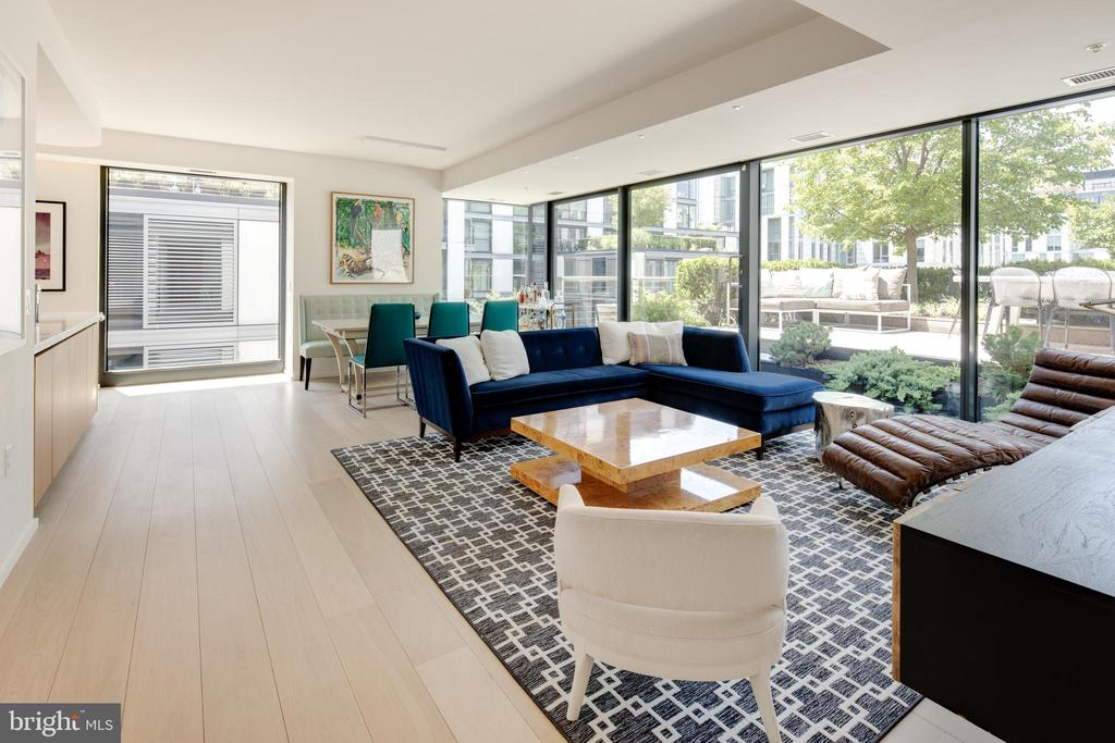 *Price Adjustment - Incredibly rare City Center terrace unit - just one of eleven available!  Designed by renowned British architecture firm Foster+Partners, this rare and highly coveted two bedroom, two bathroom open floor plan of approximately 1,584 square feet has undergone extensive upgrades by the original owners. The lush walk-out terrace of 576 square feet provides ample space for indoor/outdoor living and floor-to-ceiling glass exposures  throughout the unit provide dramatic views that can be concealed quickly by motorized shades. The owner-modified kitchen includes cabinet upgrades, premium appliances, and a paneled refrigerator. The master suite contains multiple built-in storage fixtures and a walk-in closet, while the ensuite bathroom has been enhanced by a custom dual vanity. The master and second bedroom both share a 104 square foot balcony and the entire unit has benefited from the addition of recessed LED pin lights and audio/visual upgrades. The unit conveys with two side-by-side garage parking spaces, located in the closest possible position to the elevator. A large, elevated storage unit is also included. This full-service building provides some of the best amenities and services available throughout Washington, D.C. and is home to numerous partners and professionals who work just steps away. VIRTUAL PREVIEWS AVAILABLE VIA MATTERPORT 3D VIRTUAL TOUR LINK.