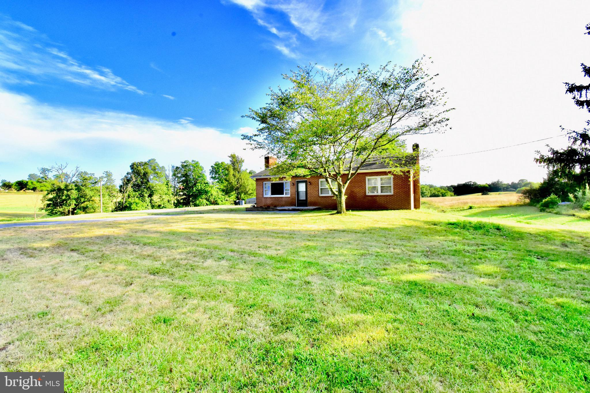 Spectacular opportunity in Middletown, VA. Unrestricted 6.6 acres with a solid brick ranch home, 5 bay garage and pond site cleared and dug. Welcome to where convenience meets affordability! Less than 3 miles to I 81 and I 66 with no HOA or restrictions! 3 bedroom 1 bath home with partially finished basement ready for your customization.  There is plenty of potential in the walk out lower level, with most of the work done to double your living space!  The kitchen has recently been upgraded with stainless steel appliances, butcher block counters and new flooring.  There is a huge garage with unlimited potential. The land is suitable for horses or livestock and eligible for tax incentives if you should choose to use it for agriculture.  Huge rear covered  deck overlooking the pond site.  Interior photos to be up soon.