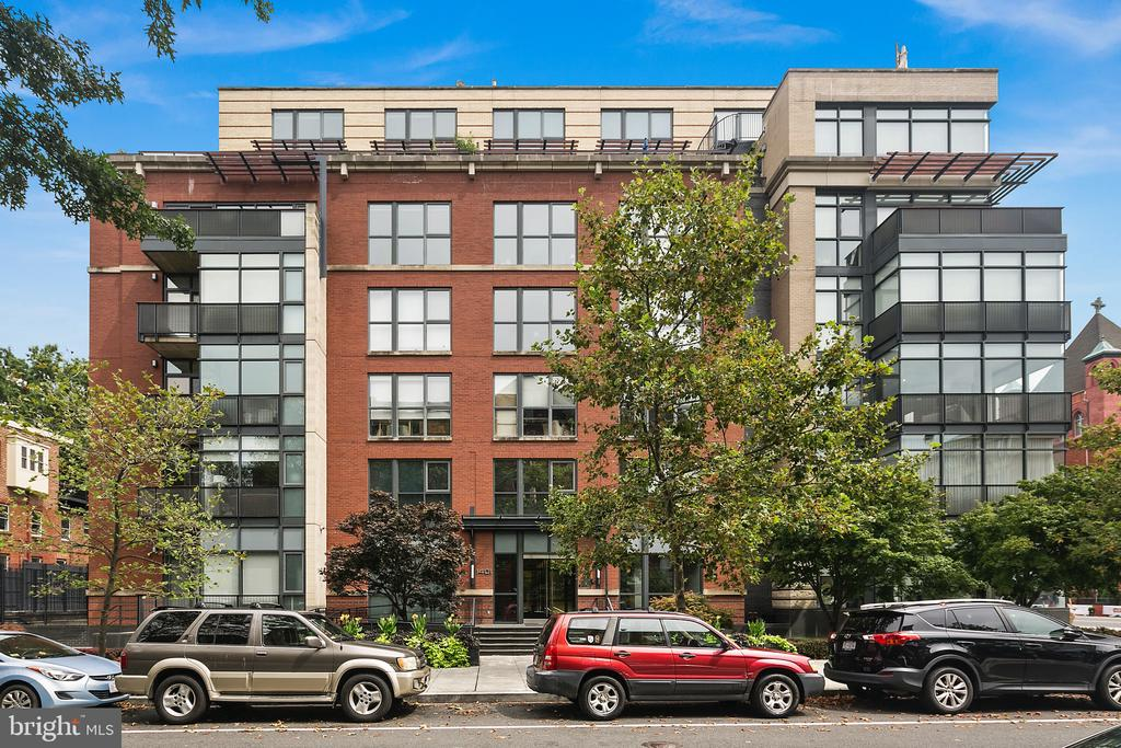 Stunning light-filled corner unit in a fabulous boutique building in the heart of Logan Circle. Two bedrooms and two and half baths with high-end finishes and floor to ceiling windows offering amazing city views. The open floor plan features gleaming hardwood floors, and a beautiful gourmet kitchen with Sub-Zero and Bosch stainless steel appliances, granite counters and gas cooking. The two bedrooms each feature attached full baths with appealing modern finishes. Separate half bath, custom lighting, integrated audio system, laundry/utility room, walk-in closet, and outside storage. Walk out the door to vibrant 14th Street restaurants, shops, nightlife, and the Metro.  Start enjoying life at 1401 Q today! Garage parking. for video tour  & 3D Tour please go to the camera icon above or cut and past https://app.struxture.net/v2/1401-q-st-nw-303-washington-dc-20009-us-377006/videos/9391 and https://my.matterport.com/show/?m=2yE9w79zp9n&brand=0&mls=1