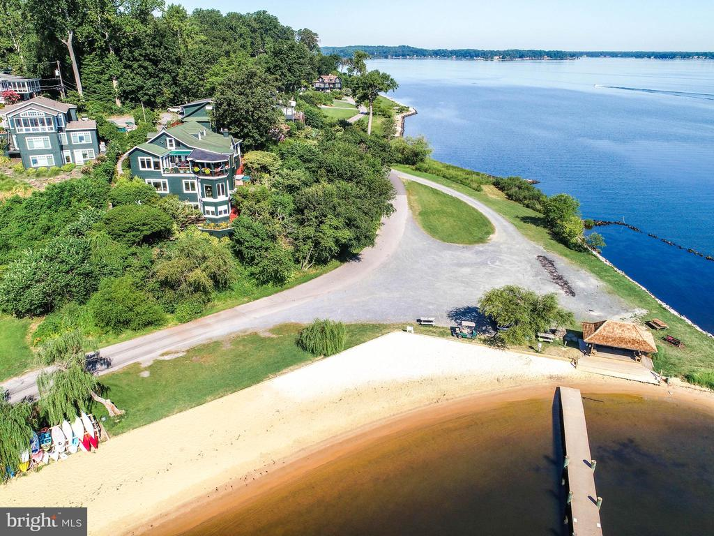 Once in a Life time Opportunity in Sherwood Forest - Views up, down and across the Severn River. Home rebuilt in 1994 by Winchester Construction with tons of high end touches.  Water view elevator to access all 3 levels.  Remote control screens that lower with a touch of a bottom,  Heated floors in Master Bedroom, Master Bathroom and lower level.  Custom Kitchen Cabinets with build it TV on counter top.  Whole house automatic generator.   New steel retaining wall installed to stabilize the hill side.  Sherwood Forest is a gated private community consisting of 341 homes.  The community amenities include a Large Multi-Purpose Club House, General Store, 9 Hole Golf Course, 6 Tennis Courts, Marina, Beaches, Swimming Pool, Basketball Court, Bowling Alley, Pickle Ball Courts, Archery Pit, Nature Lab and a very popular Children~s Summer Camp Program.  Fields exist throughout the neighborhood for Lacrosse, Soccer, Football, Softball, Volley Ball and Badminton.  The outer forest has 5+ Miles of walking and mountain biking trails thru the beautiful natural wooded scenery.  There is a ~2 mile loop around the waterfront with views of the Severn River and Brewers Pond.  Golf Carts are the transportation of choice thru out the neighborhood.  The social calendar offers many activities such as the 3rd of July Fireworks, 4th of July Parade, Summer Dances, 5K Race, Corn Roast, Clam Bake, Tennis and Golf Tournaments and many more~ The Holidays are always special with events for Adults and Children. A one-time $15,000 membership fee to join the Sherwood Forest Club is required as part of your Real Estate Transaction.