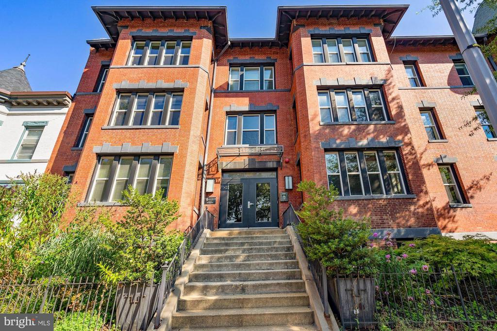 OPEN SUNDAY (8/9) from 1 PM - 3 PM.   Welcome to this luminous 2BR/1BA corner home with North, South, West & East exposures at the boutique Flatiron Condo in coveted Bloomingdale.  Residence 5 is perfectly situated on the 2nd floor of a charming 8-unit walk-up building so it's not too high where stairs can get cumbersome and not too low where light and views can get compromised.   Featuring only two residences per floor, the Flatiron, which was originally built in 1909 and underwent a gut renovation in 2011, is a friendly, intimate building with low condo fees and lots of charm and character.  This is the ideal home for a discerning purchaser looking for something unique and special.  You won't find generic, cookie-cutter construction here.  Residence 5 is a lovingly maintained home.  It's freshly painted and features hardwood floors throughout; tall ceilings; expansive windows with remarkable light; a delightful and inviting balcony with tree-lined views; gas cooking; tankless hot water heater;  in-unit washer & dryer.  There is only 1 shared wall with another neighbor.  The Flatiron is a pet friendly building with a beautifully landscaped community garden and it's situated in the heart of Bloomingdale, one of the city's BEST neighborhoods.  It's a walker's paradise.  Bloomingdale is packed with treasures--both hidden and celebrated--from the Red Hen, Bloomingdale's culinary heart, to Big Bear Cafe, a neighborhood staple, to wondrous Crispus Attucks Park and LeDroit Park.  These gems and so much more, from unassuming dive bars to surprise parks to award-winning restaurants, are just steps from your front door.  The Shaw Metro is a 10-min walk.   Please click on to the VIDEO TOUR that is included in the listing to see more!