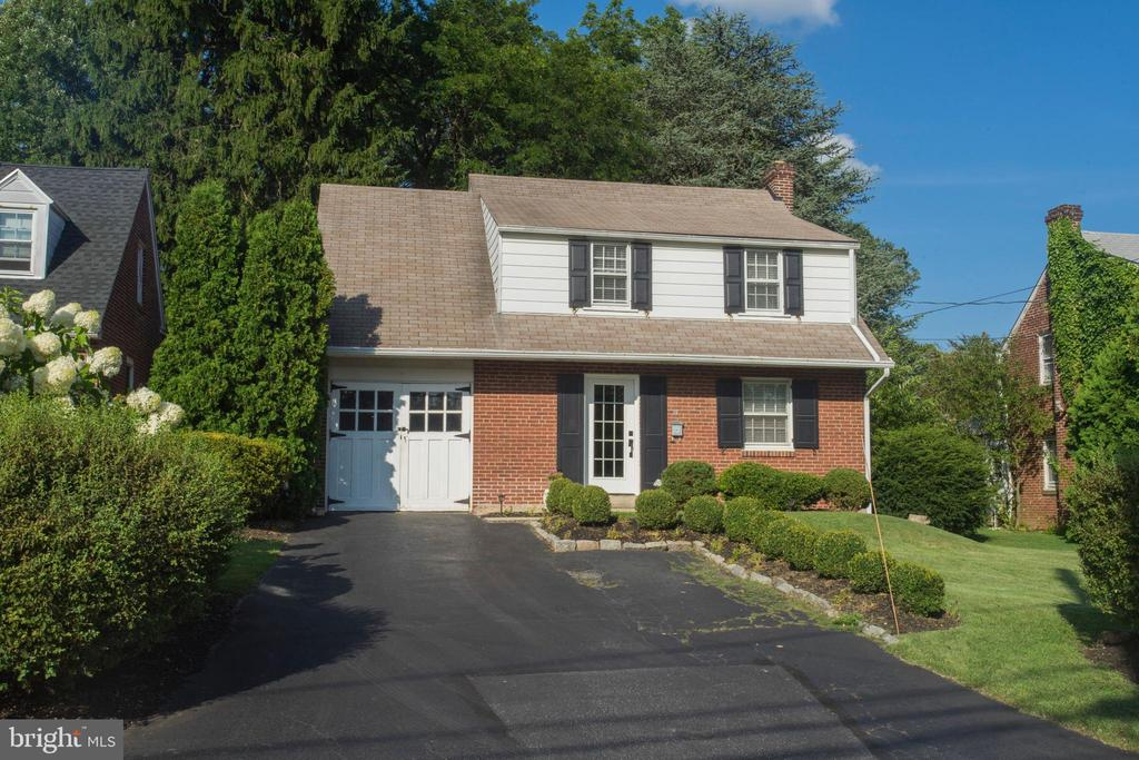 Welcome to the best location for your money in Willistown Township. This 4 bedroom/2 full bathroom brick colonial offers an open floor plan with a 1st floor master suite, hardwood floors throughout and a flat fence in yard. Set in a peaceful neighborhood, in the highly sought after community of Paoli Gardens, this charming home is less than a 5 minute drive minute or 10 minute walk to Paoli Train Station, downtown Malvern,  Greentree Park and Paoli Hospital. Enter the first floor of this beautiful home and you have a living room that flows into the open design kitchen and dining area which is great for entertaining. The kitchen features stainless steel appliances, granite counters with plenty of cabinet and counter space as well as gas cooking which is every chef~s preference. The 1st floor master suite with a new full bathroom and walk-in closet makes this home so versatile. This spacious master could be used as a family room which features double French doors leading to the backyard. Dine Al Fresco on the deck or enjoy the ambiance of the gazebo at night. The second floor has 3 additional nice size bedrooms and 1 full bathroom. The full basement adds extra space, plus a convenient attached garage and shed out back. Don~t miss living on this quiet street, just minutes to the heart of downtown Malvern.  Enjoy dining and shopping on King Street. This is a perfect location with easy transportation options in the Main Line.