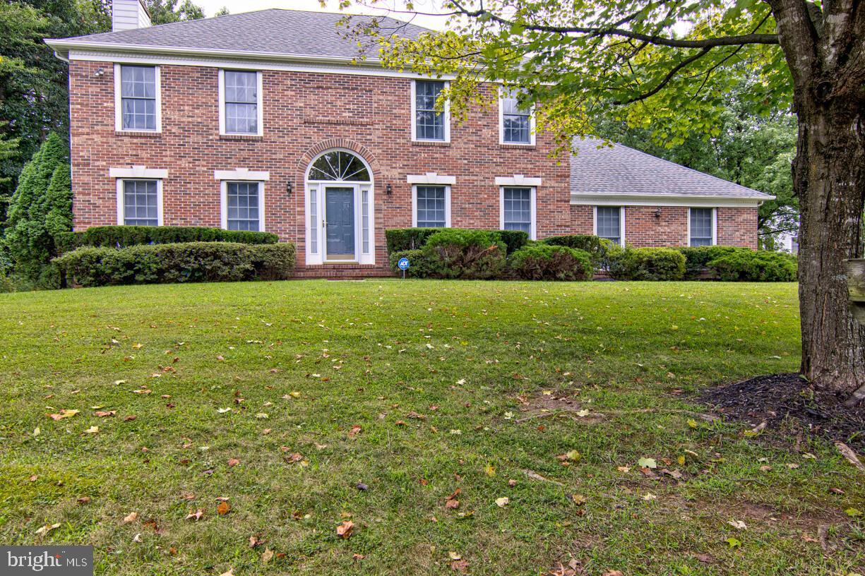 The Second Owner of this Former Model Home is Ready to give you an Opportunity to Enjoy This Beautiful 4 Bedroom 3.5 Baths Brick Front Colonial. It Features a 2 Story Hardwood Foyer, Formal Living Room and Dining Rooms with Hardwood Floors*Large  Family Room with Fireplace, Built-in Book Shelves and 9 Foot Ceilings, just a few steps to your Breakfast Nook and Kitchen*Master Suite with Master Bath and Walk-in Closet*Fully Finished Basement with 5th Bedroom,Full Bath and Summer Kitchen*All Located on Almost a Half Acre Corner Lot,Large Deck with Access from Breakfast Nook and Family Room Plus a Side Entry Two Car Garage. Replaced Roof & HVAC units in 2014 and Deck 2020.
