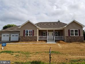 New construction  - ranch home with side garage entry.  3 bedroom, 2 1/2 bath, full basement with egress window, well, septic.   Photos are of similar home - changes include side entry garage,  shower only in master bath.  See floor plan under documents