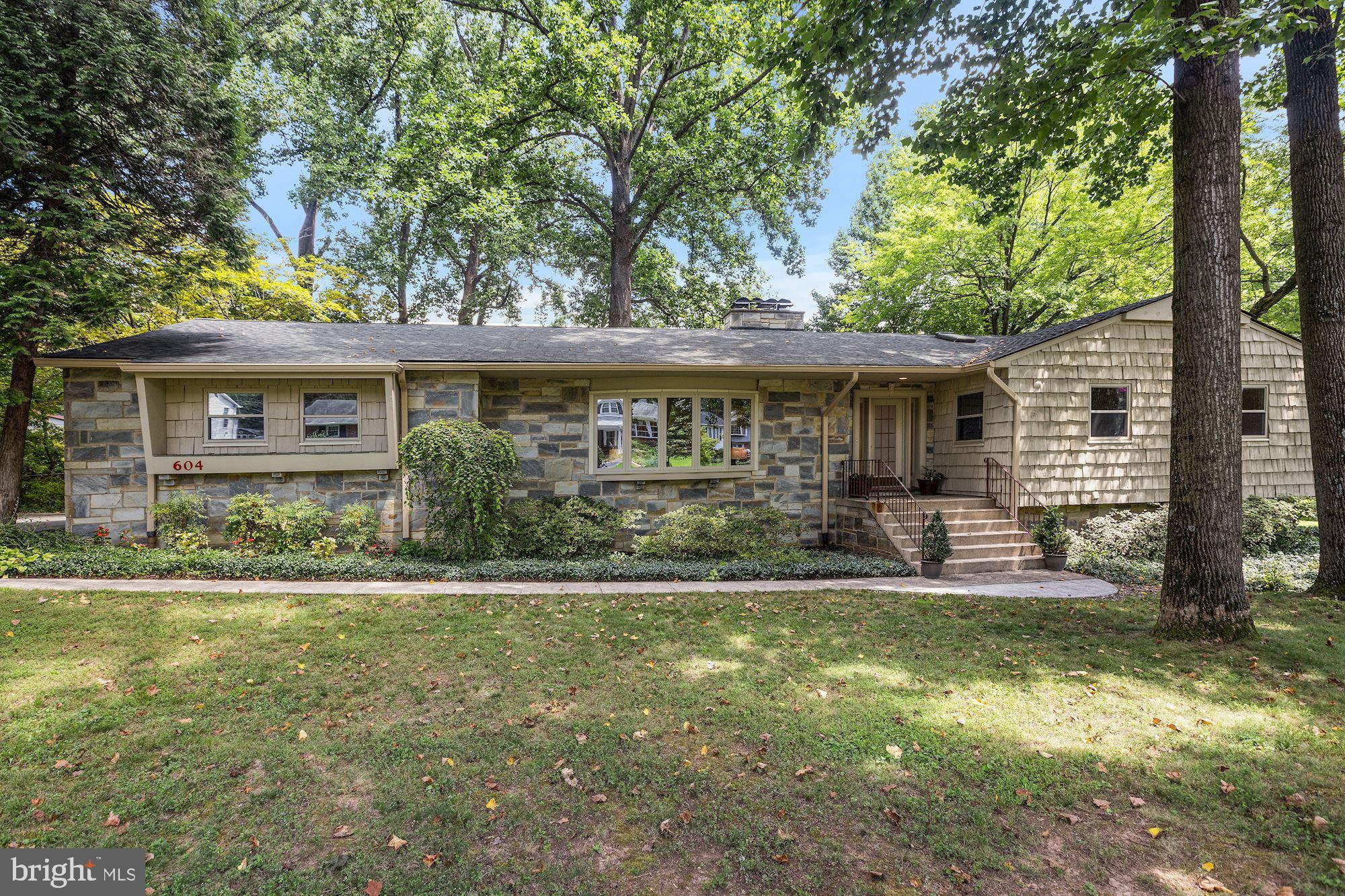 Beautifully maintained mid-century modern on a cul-de-sac with 4 bedrooms, 3 full and one half baths, and an attached two-car garage on a half acre lot in Falls Church City! Enter from the elevated front porch into a lovely foyer that steps down to a formal living room with hardwood floors, recessed lights, built-in bookshelves and a wood burning fireplace with stone surround. The formal dining room is perfect for entertaining and opens to a Florida Room with access to the 2-car garage. An updated kitchen complete with granite counters, custom high-end cabinetry, stainless steel appliances and recessed lights makes you feel like you're in the outdoors with the huge picture windows. The kitchen adjoins a breakfast room with another wood burning fireplace, all overlooking the picturesque, treed back yard. Enjoy a main level master suite with walk-in closet and updated bath. Across the hall, 2 more bedrooms share a full bath. A large lower level features an additional bedroom (with its own private entrance) and an office with a walk-in closet. A full bath with a conveniently located laundry room are just down the hall. The spacious rec room with wood burning fireplace and wet bar connects to a powder room and large storage room to complete the lower level. Ideally located just steps from Roberts Park and the W&OD Trail and moments to West Falls Church Metro, I-66 and the highly rated schools of Falls Church City!