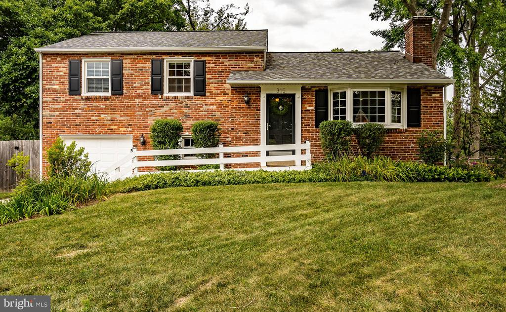 Welcome home to 315 Landsende Road, a beautiful split level home in the award winning Tredyffrin- Easttown School District. As you enter through the front door you are greeted with a tiled entryway. On the right hand side you will find a large living room with a large bay window, a gas fireplace, and hardwood floors. Just past the living room is a large dining room complete with built-in shelving. The kitchen has newer stainless steel appliances, tile flooring, and plenty of countertop space and storage. The second floor has three good size bedrooms with ample closet space and plush carpeting. The master bedroom has a spacious closet and a half bathroom. A large full bathroom with a double vanity and shower/tub combo completes this floor. Downstairs from the kitchen there is a newer large laundry area with a sink, plenty of cabinet space, granite countertops, and a stackable washer/dryer. A cozy den is located adjacent to the laundry area. The large finished basement boasts even more living space with brand new carpeting, an office area, and a large utility room. The garage is located off the laundry area as well as an entrance to the large fenced in backyard that has mature plantings, raised garden beds, a beautiful paver patio area, and mature trees.  A new roof was installed in January 2020! Landsende Road is located within close proximity to 202, 76 & Rt 30! Don't miss your opportunity to call 315 Landsende Road your new home!