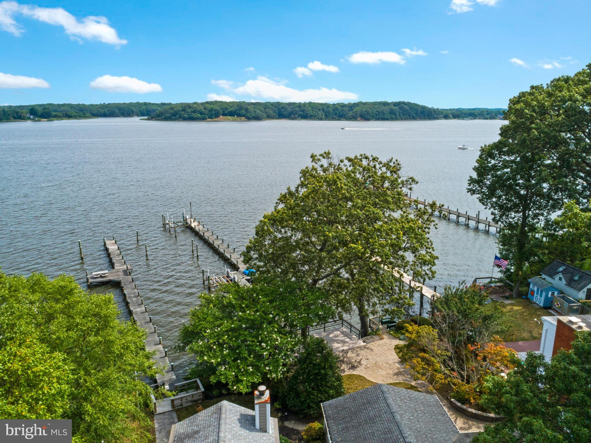 Great opportunity for a 4000+ SF waterfront new construction with expansive views .  Building permit in hand.   This home is to-be-built by Whitehall Building in the sought after community of Loch Haven with panoramic views of the South River.     The existing home will be torn down and the new house will be built.   The property already has a pier with two boat lifts and an electric tram to the pier from the deck.    The cantilevered deck is grandfathered in and provides additional outdoor living space.   The builder is not cutting corners - the base price is inclusive of Hardie Siding, Andersen windows, hardwood floors, ceramic bathrooms, granite countertops, 9' ceiling on the main and upper levels and a fireplace as well as a finished basement.     The open family room, dining area and kitchen all look out to the water.     The kitchen island is the perfect central location of the space and there is a pantry/mud room between the garage and kitchen.   Screened porch on the water side.   The upper level has a laundry room, 3 bedrooms with walk in closets and 3 full bathrooms.   There is a home office on the main level.   The above grade square footage is 3210 and with the basement is 4325.  As far as the views, they are amazing.    This property is located at one of the wider sections of the river the house looks directly over the river to Quiet Waters Park in Annapolis.    It's quick and easy access to the Bay or to waterfront restaurants.     The permits will be applied for once the Buyer (could be you!) decides on their final house design and plans.    You can build this house or any other that will fit into the lot building footprint.     The builder is flexible to work with your design preferences.    Construction-Perm financing or Cash.    $10,000 toward selections/finishes for using the builder's preferred construction-perm lenders and title company.     The builder has already sought out the lenders with the best construction-perm programs.    The photos he