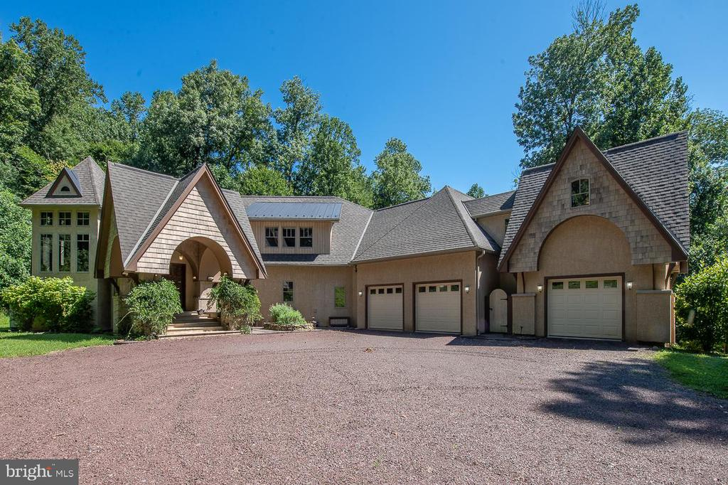 Located  in the heart of historic Birchrunville is a 3 acre serenity inspired oasis set in the natural lands of French Creek.  Designed and crafted by Allen Entrekin, this one of a kind custom home is designed to integrate the owner w/nature while utilizing  the most advanced GREEN TECHNOLOGY and building systems. From the prefabricated walls offering staggering insulation values, to the state of the art home Crestron automation and lighting system. As you walk through the entrance, the indoor water feature greets you with a tranquil sound. This remarkable home is graced by soaring ceilings, breathtaking architecture, and wall-to-wall windows. The open floor plan offers a kitchen with granite countertops,  stainless steel appliances, cherry cabinets, deck and screened in dining area. The main floor master bedroom is connected to the main house by a raised bridge; the original landscape plan was to have a manmade stream running under the bridge.  For possibilities future  owners can see the animated link. https://www.youtube.com/watch?v=c5_mIXvp_VM. The master bedroom has an ensuite bathroom with open shower, spacious walk-in closet, and lower level gym. Upper level offers a office work area, 2 additional bedrooms and two full bathrooms. Daylight walkout lower level includes an in-law suite with full kitchen, art wall and a secret doorway that leads you to a mine shaft hallway with three theme rooms and  two full and one half bathrooms. An enchanted garden room, crystal room, and bunk bed room. The indoor water feature, crystal room, and well thought out design of this property truly provide a spa like feel for renewal of mind, body, and spirit. Property has a whole house commercial grade generator. Conveniently located close to the Birchrunville Post Office, restaurant, cafe, route 100 and the PA turnpike.